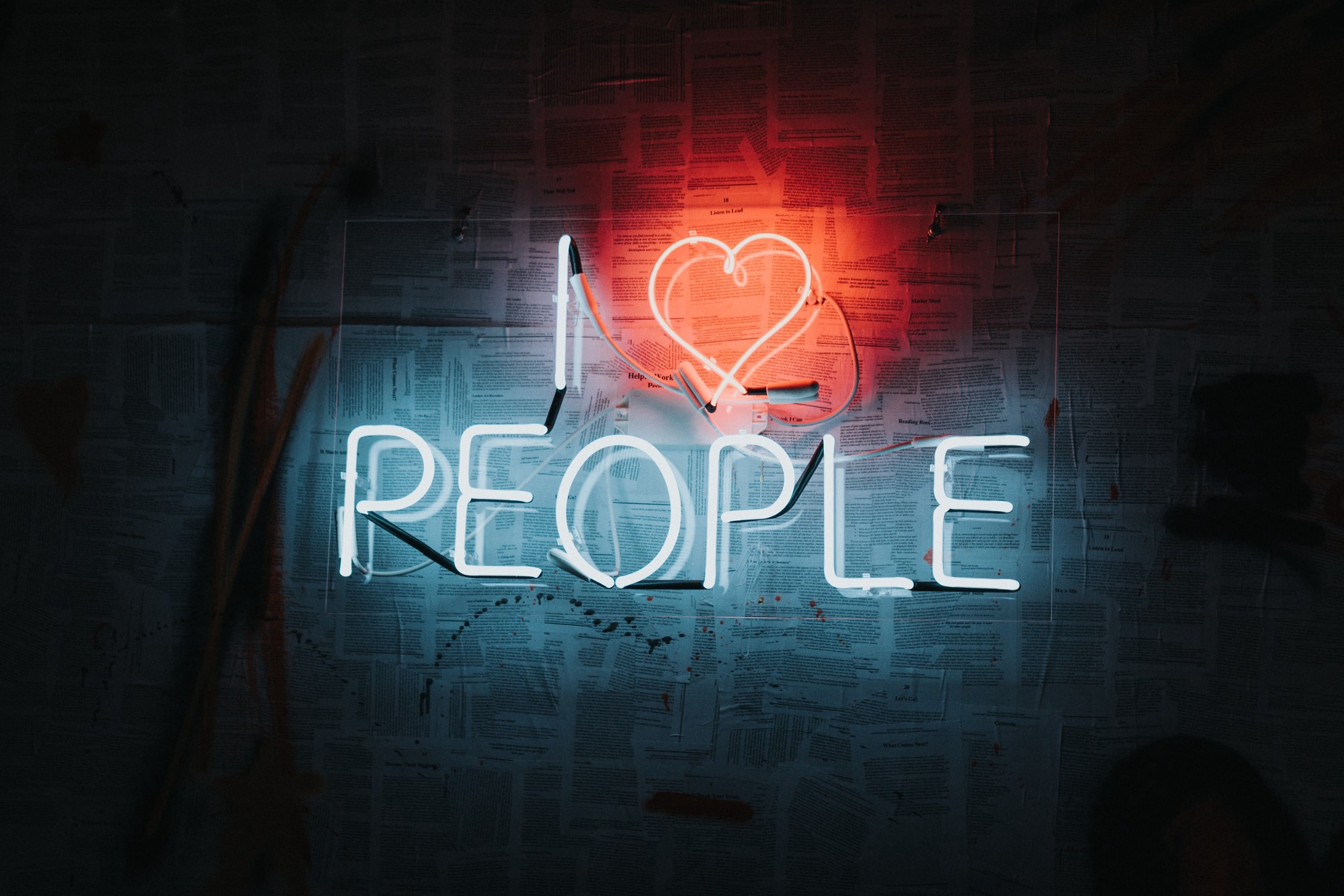 A neon sign saying I love people