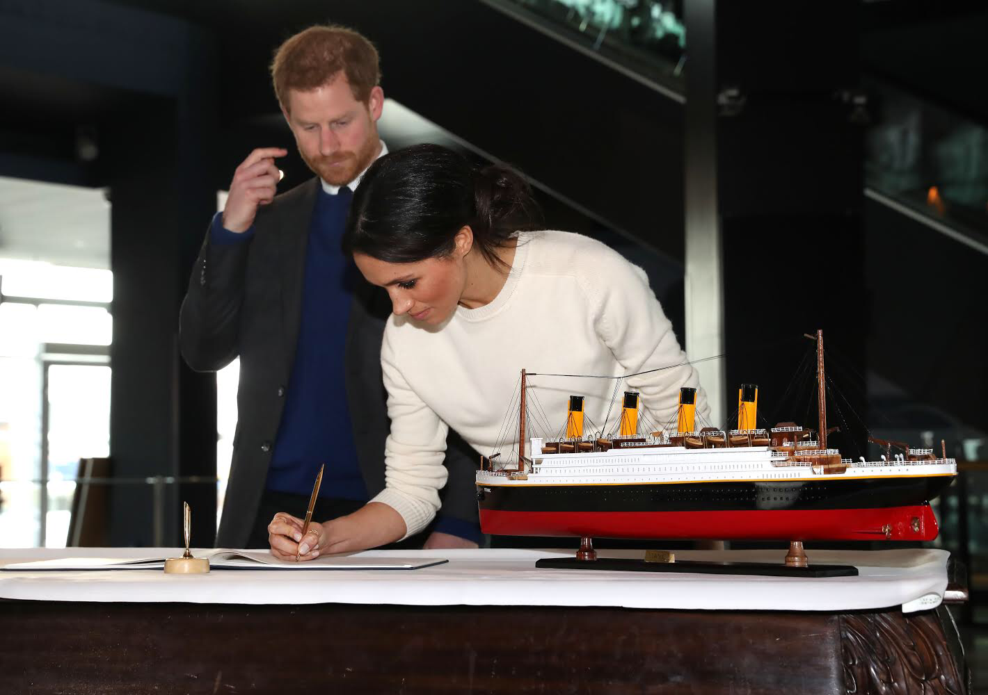 Prince Harry and Ms. Markle signing a guestbook
