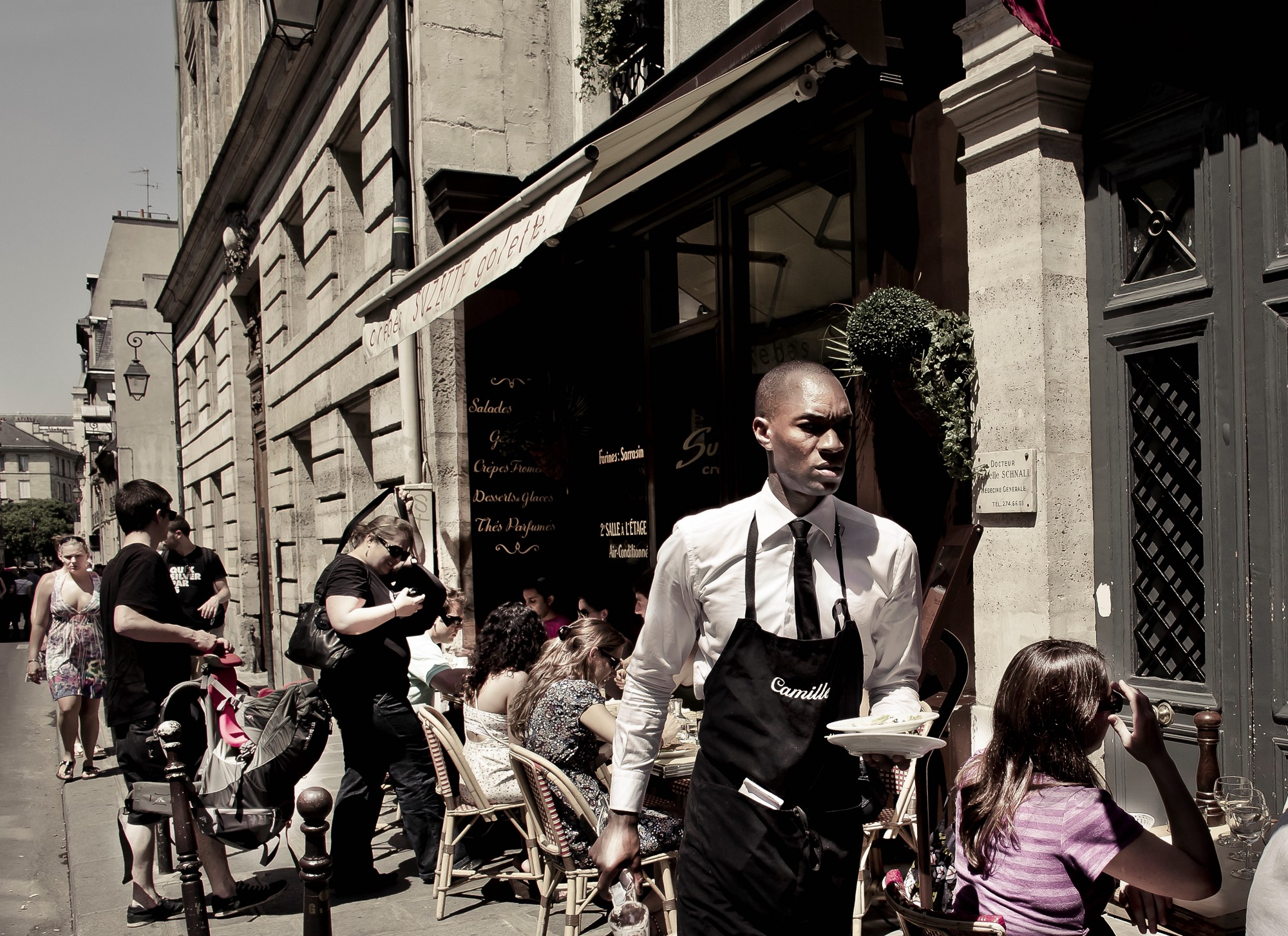 A waiter on the streets of Paris who is important to the story of an old man and his friend in Paris