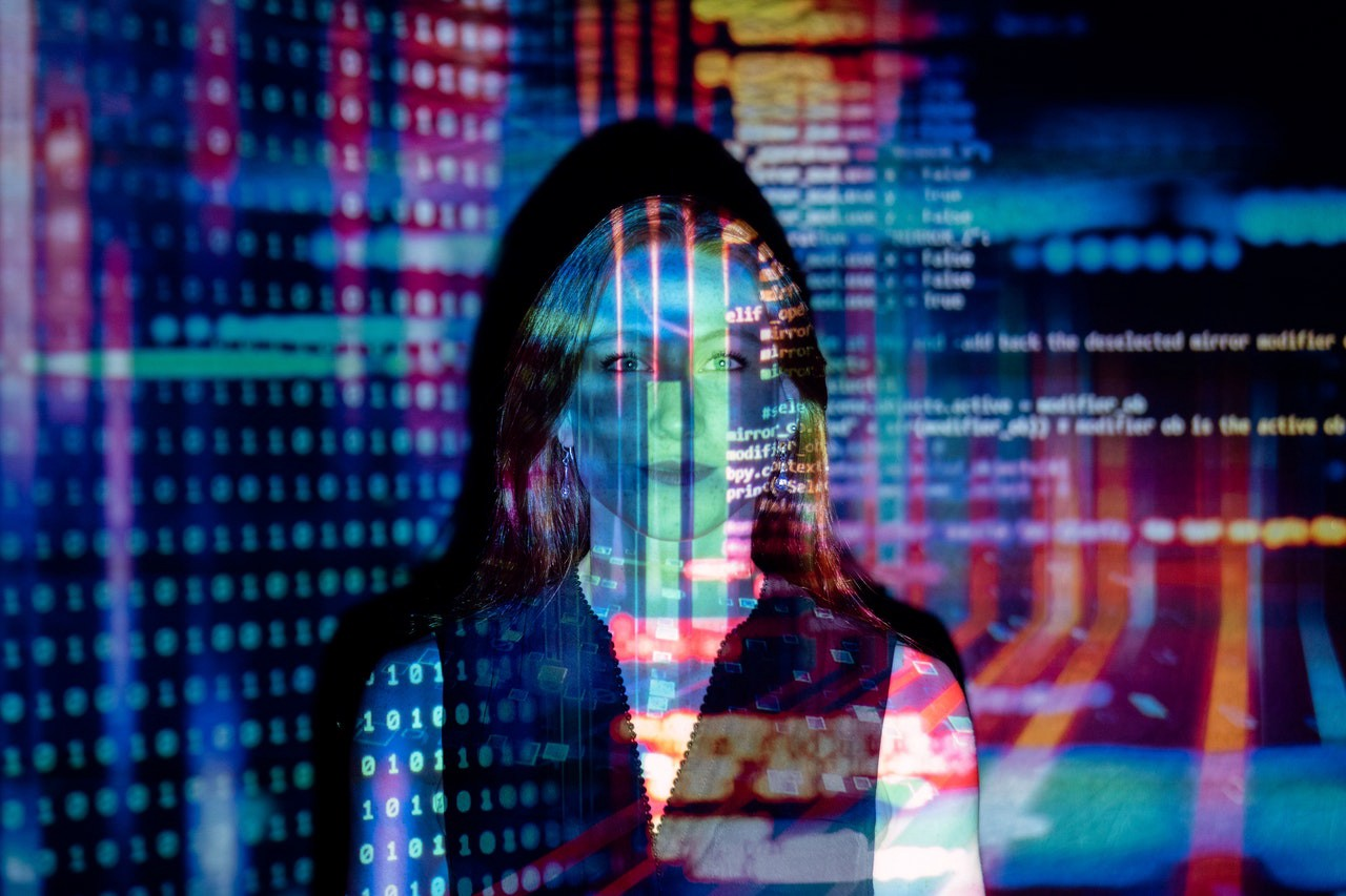 Programming code projected on a woman