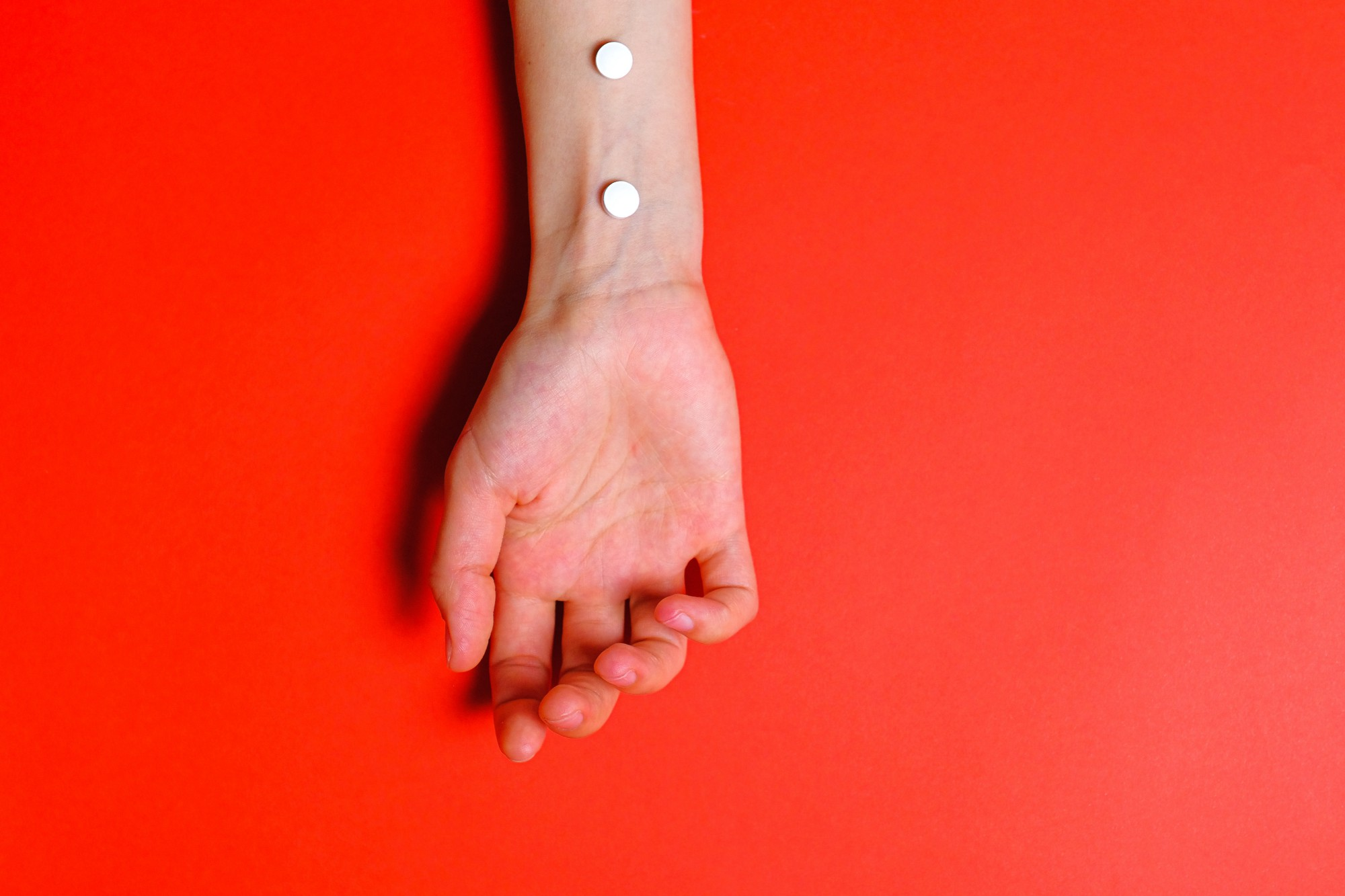 Red background and white hand on it drugs.