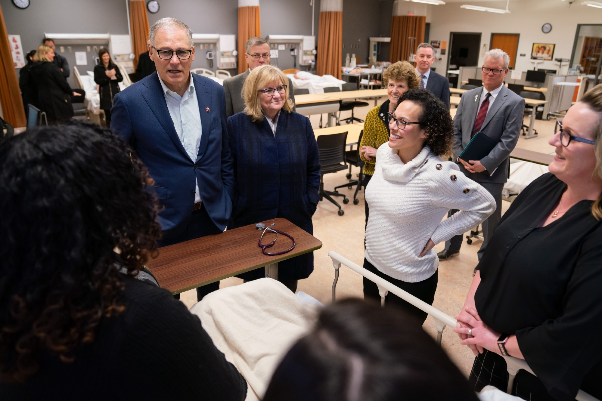 Gov. Jay Inslee and Trudi Inslee visit Pierce College, one of the institutions whose students may benefit from the expansion.