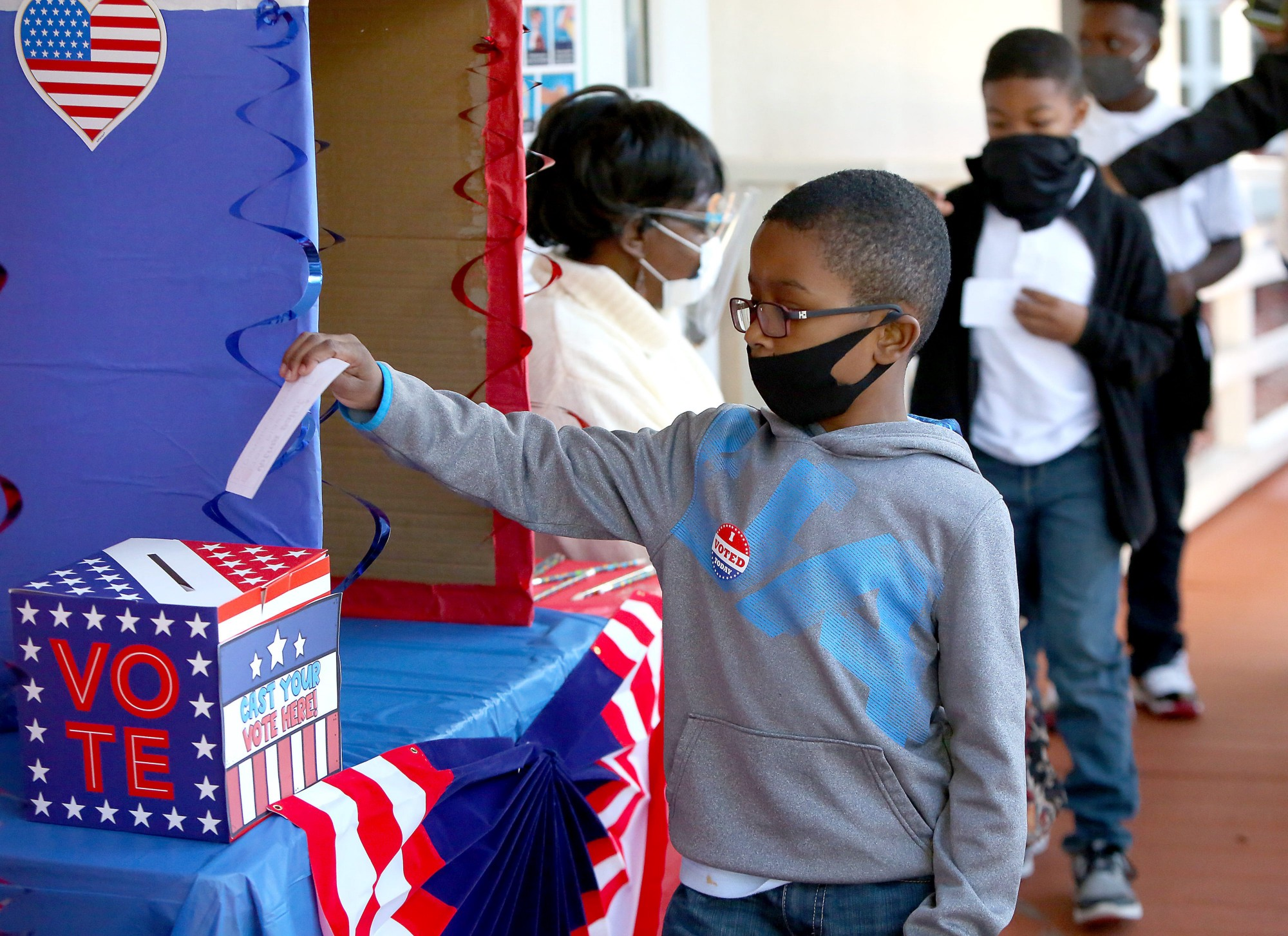 A 2nd-grader votes in a mock election at his school in Gainesville, Florida, November 3, 2020. Photo by Brad McClenny/Reuters