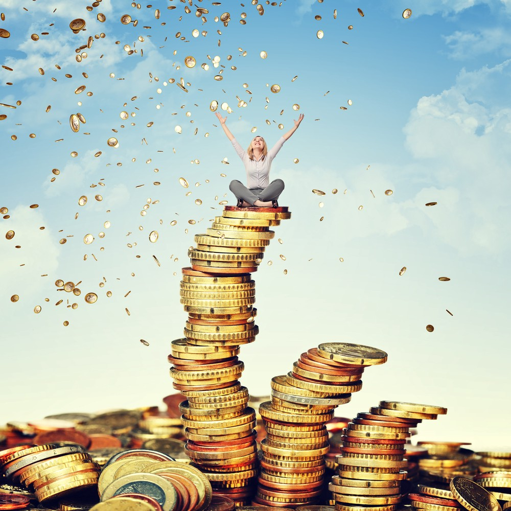 Image of a woman sitting on a pile of golden coins—the idea of the pic is 'getting rich'