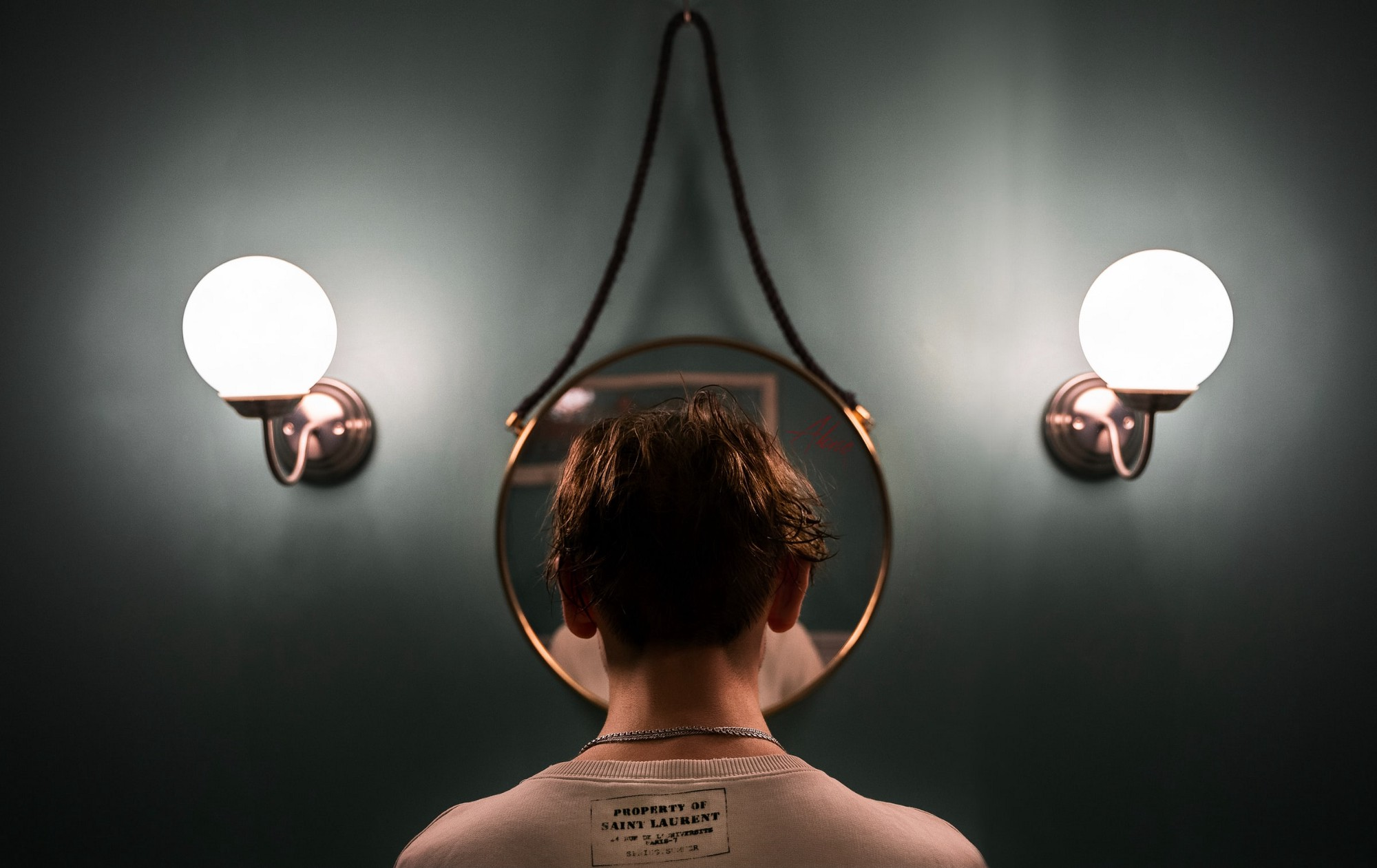 Boy standing in front of a mirror