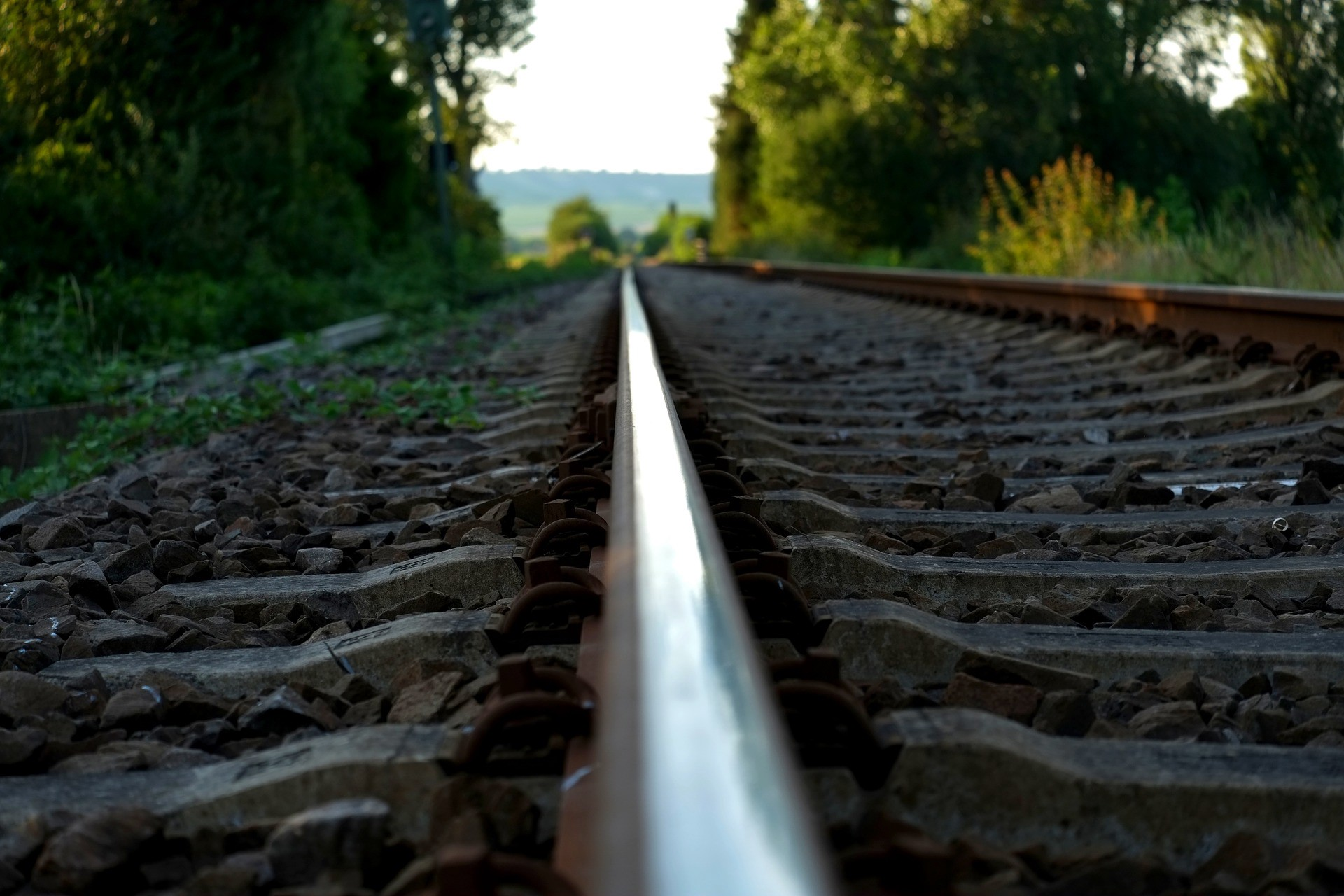 railroad rail in the midst of blurred background of nature