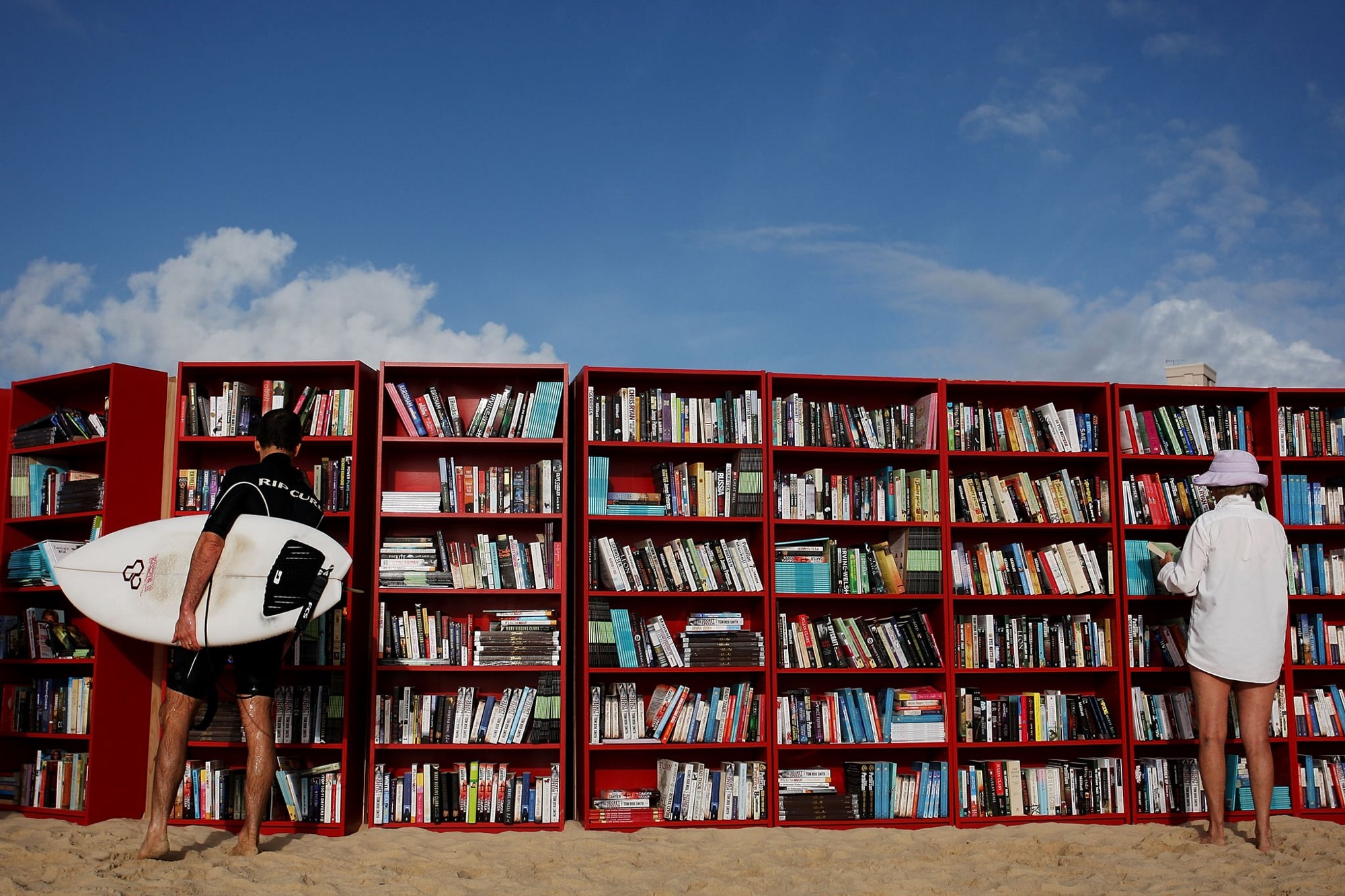 Surfer by a bookshelf at Sydney's Bondi Beach