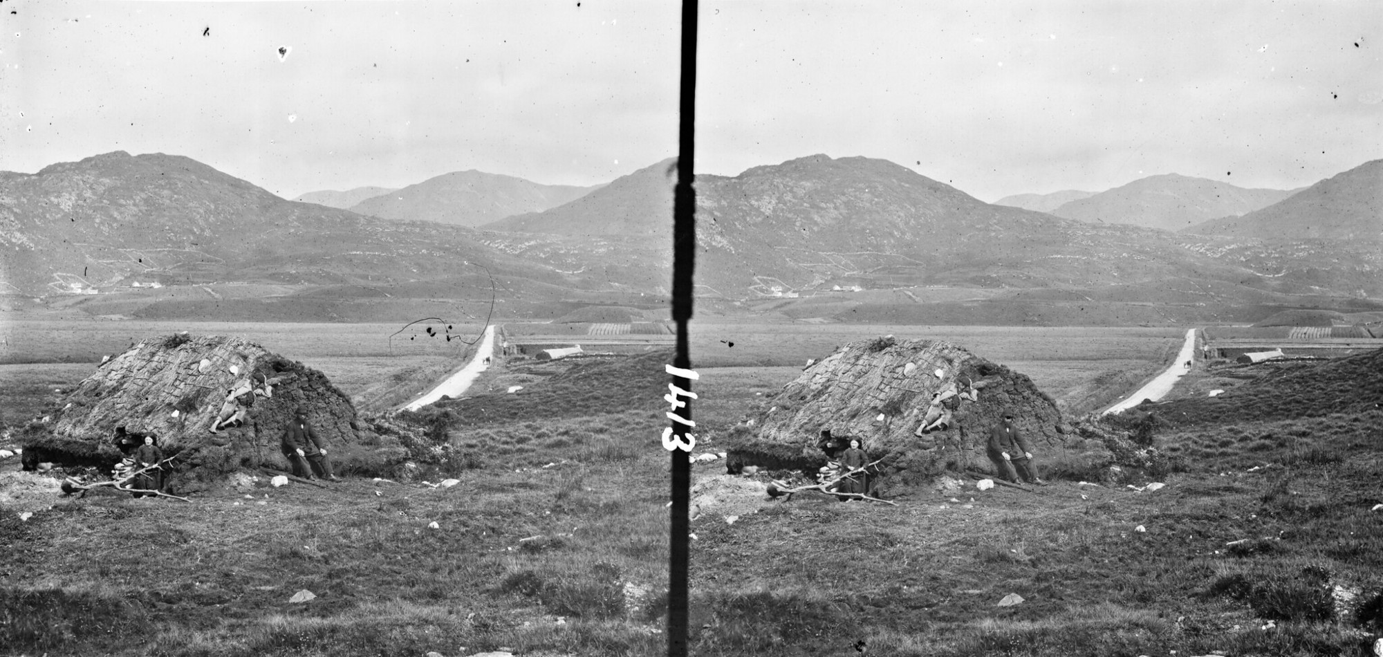 A stereo photograph, taken sometime between 1860 and 1880, showing men cutting turf from a bog in Connemara.