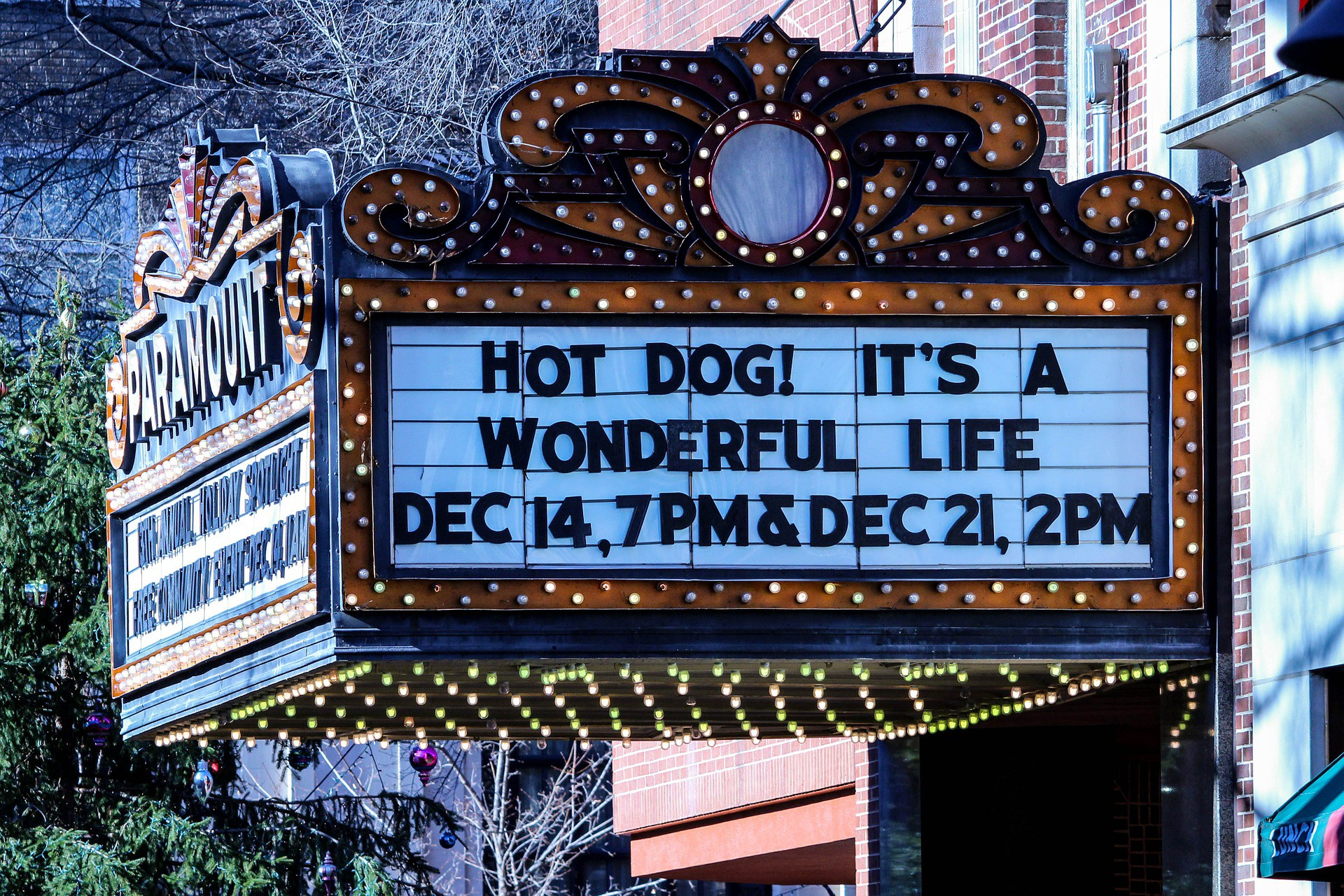 """A theatre marquee reads """"Hot dog! It's a Wonderful Life"""" and the dates and times when it will appear there."""