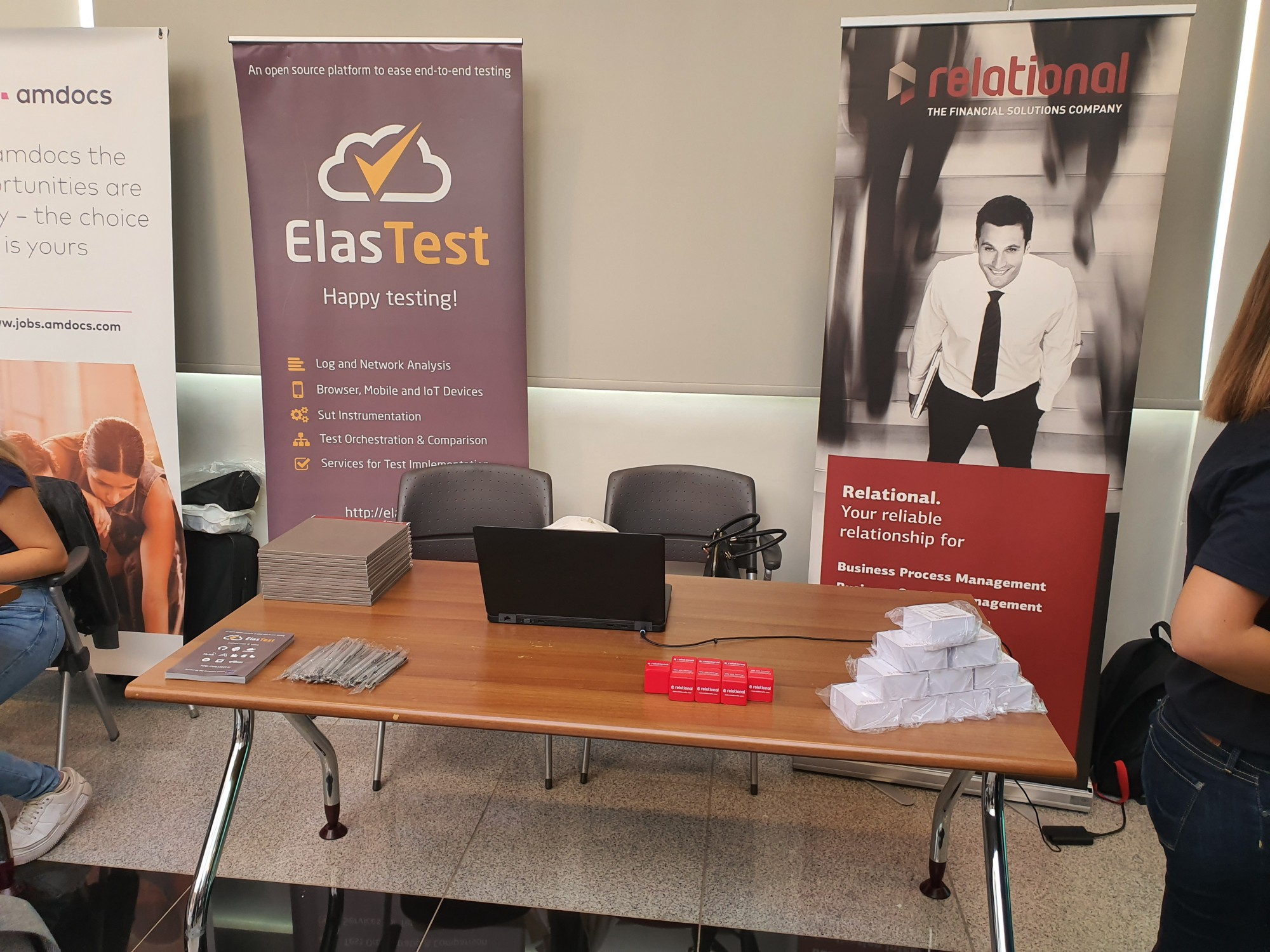 Relational booth with the ElasTest poster, stickers and flyers