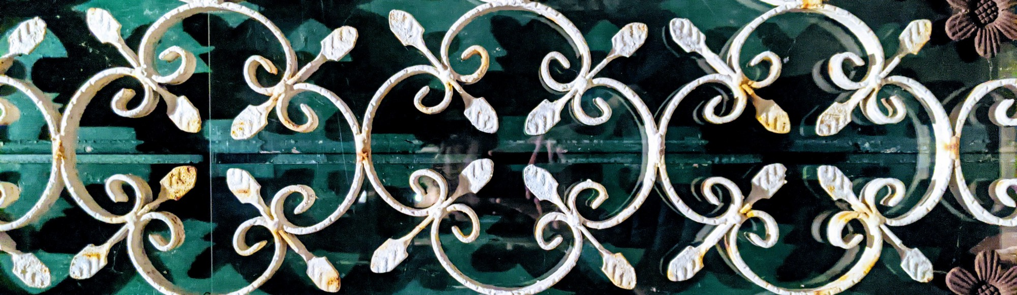 Wrought Iron Fleur-de-lis on a saturated, green background