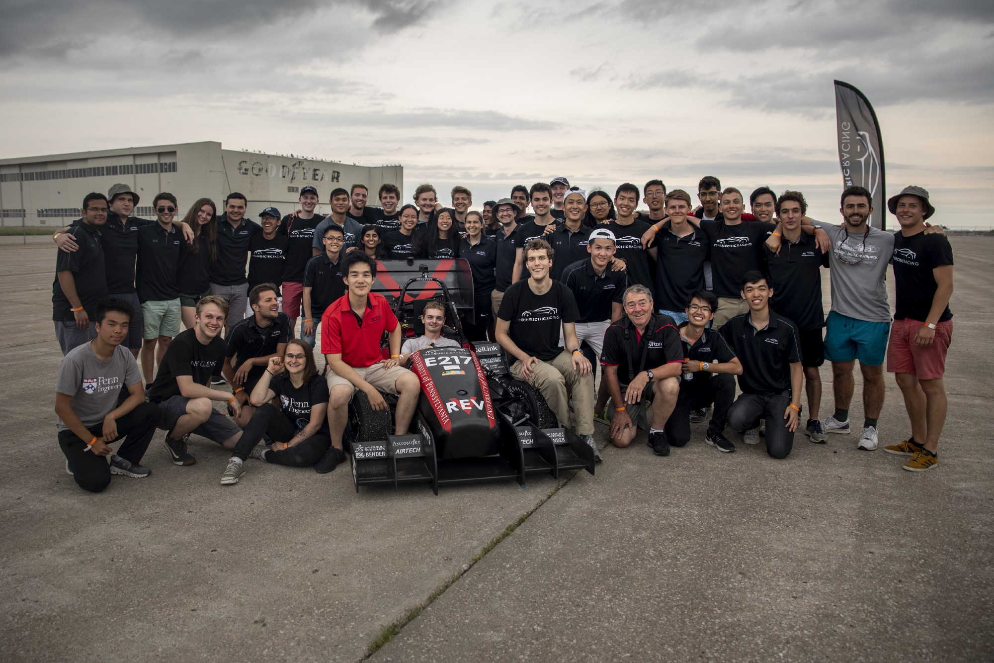 The Penn Electric Racing Team poses with REV5 at Formula SAE Lincoln Electric.
