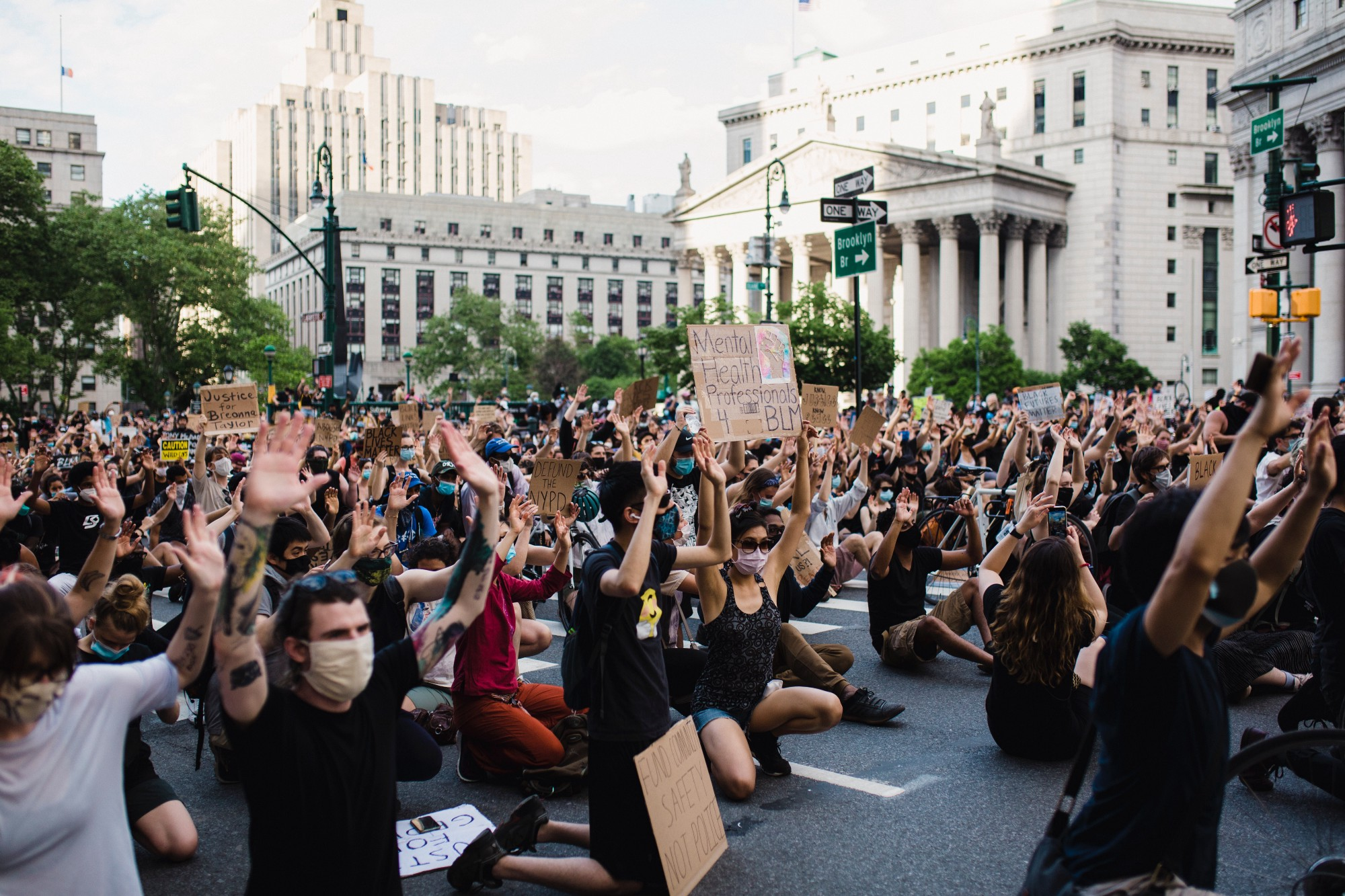Crowd of people, predominantly White, participating in a Black Lives Matter Protest