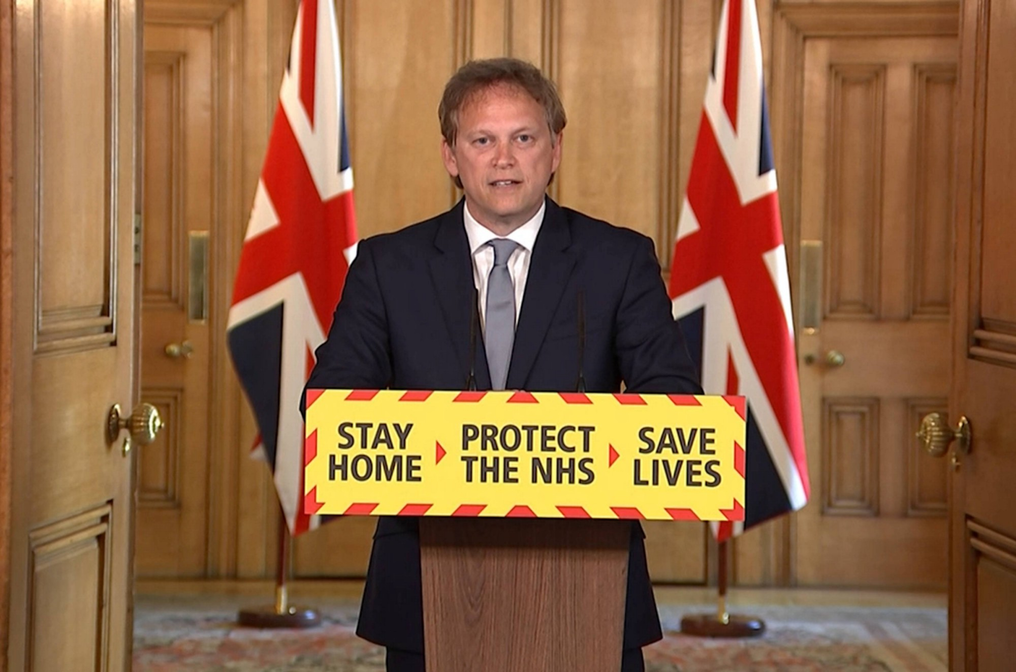 UK Transport Secretary Grant Shapps presents at the №10 lectern for the daily Downing Street briefing.