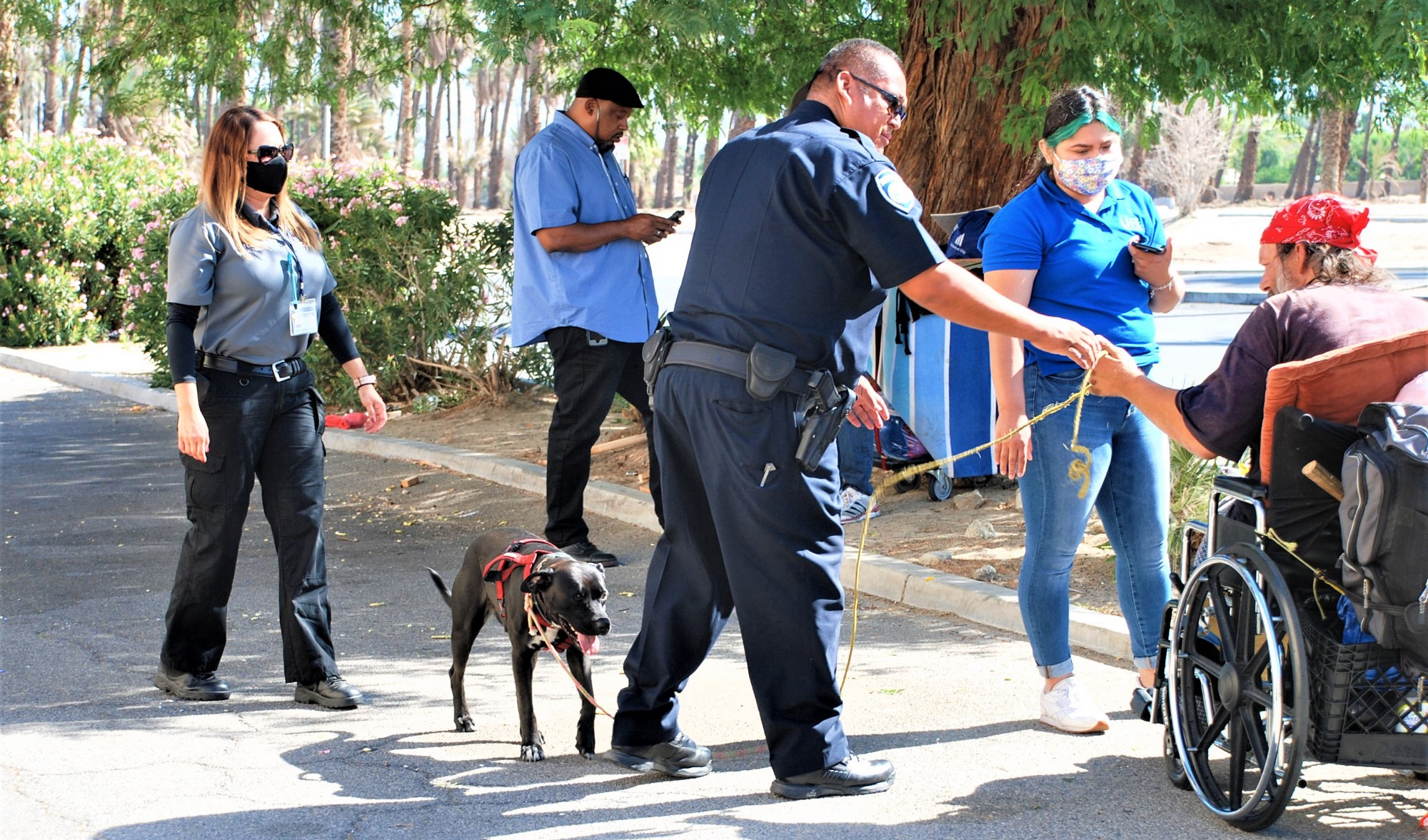 Officer Jose Ibarra and clinical therapist Cynthia Ferreiro (far left) assist a man in Indio, California. Photo courtesy of Indio Police Department