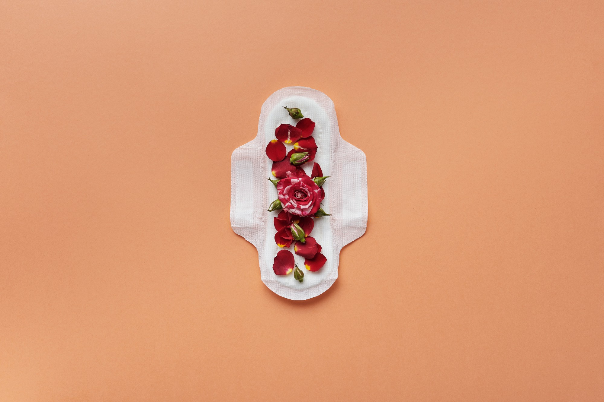 Woman's feminine hygiene product with rose petals