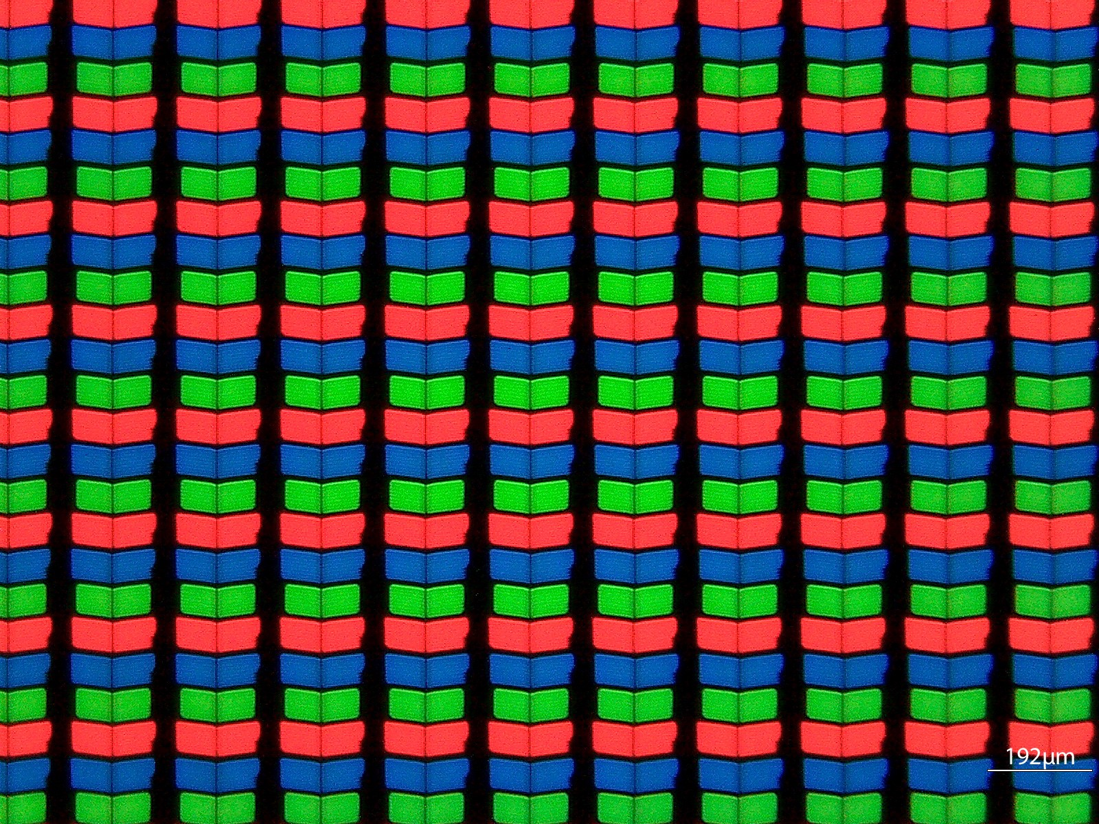 A closeup photo of red, green and blue pixels under a microscope.