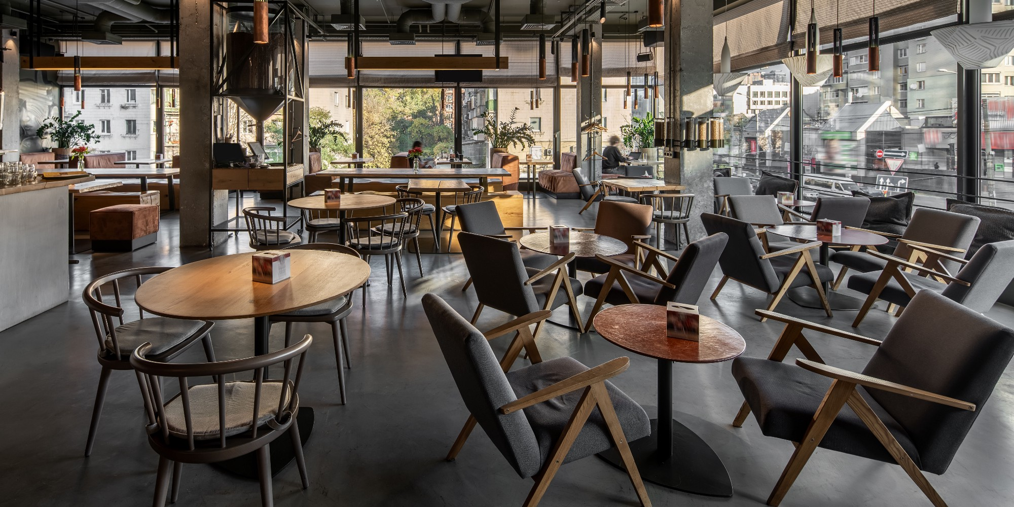 Image of a café room filled with tables and chairs