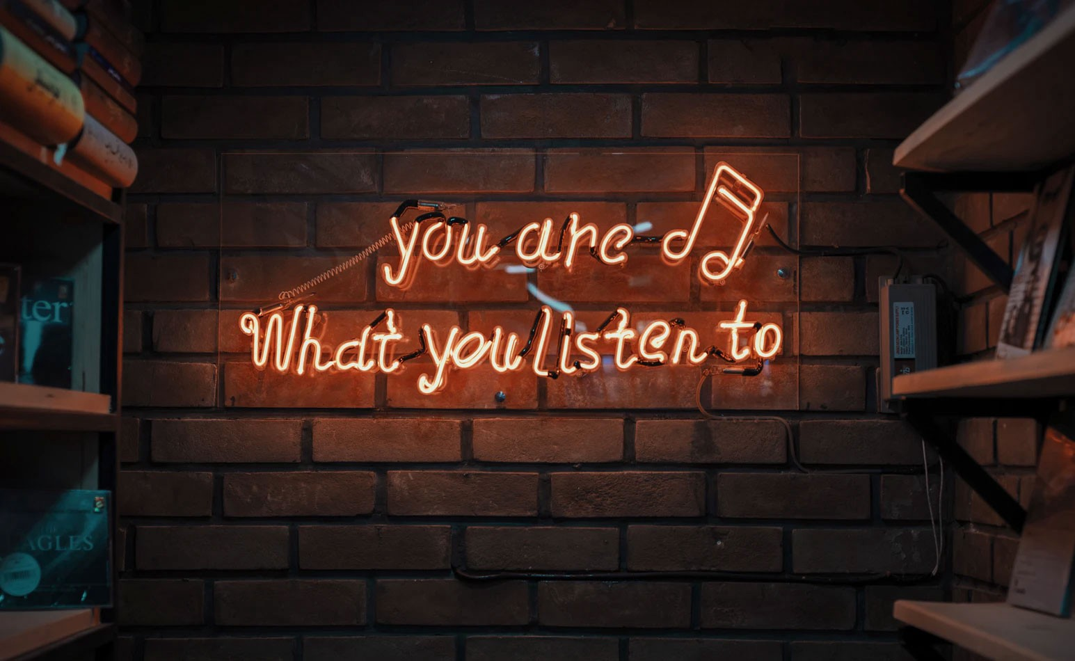 Neon sign that reads you are what you listen to.