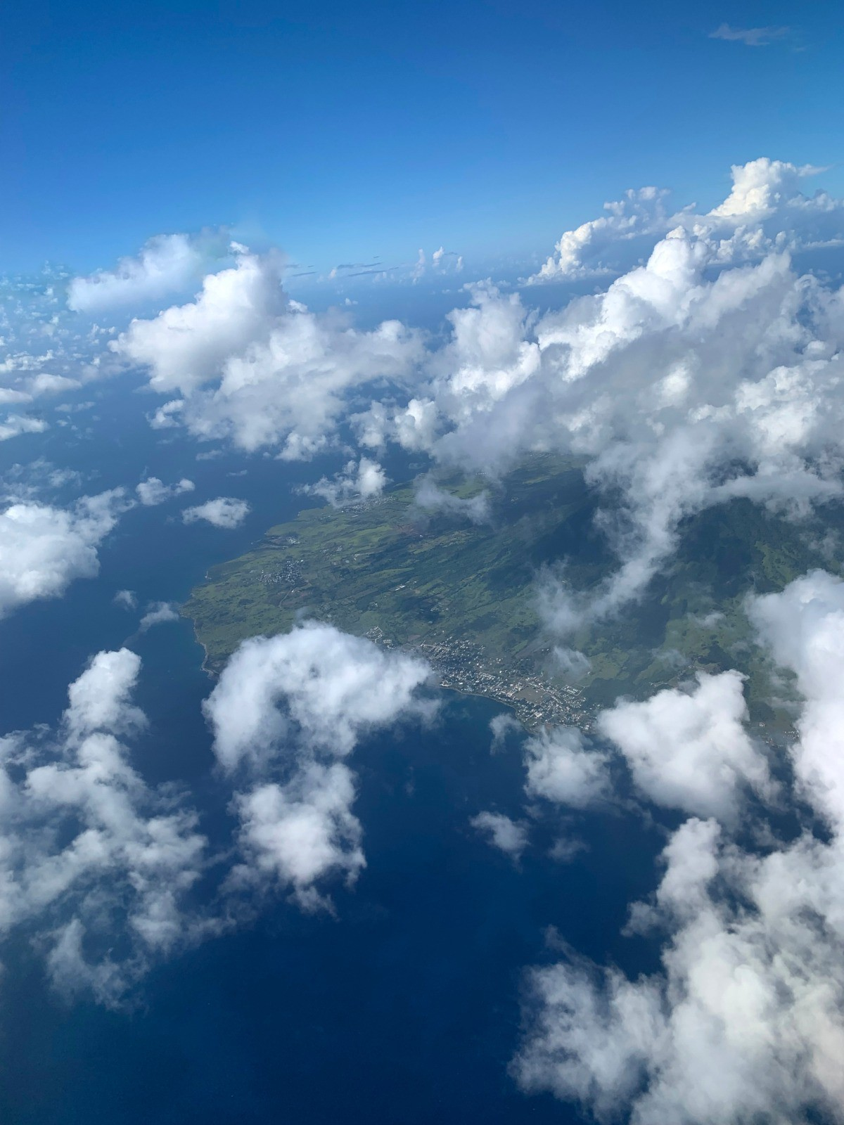 an image of a small island taken from an airplane