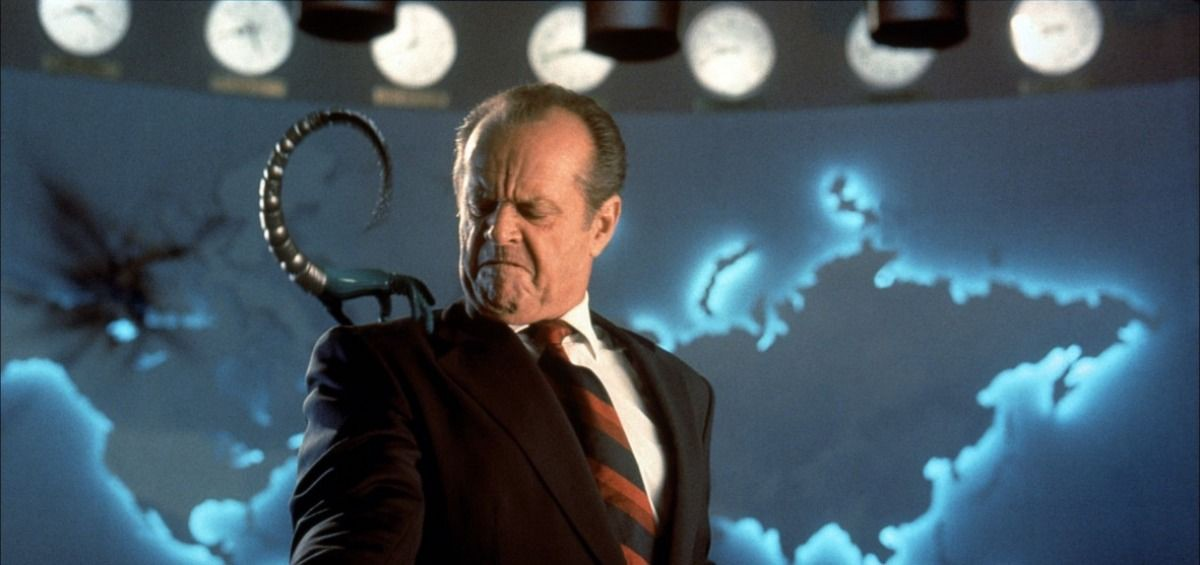Jack Nicholson as President James Dale looking disgustedly at a robotic Martian device perched on his shoulder.