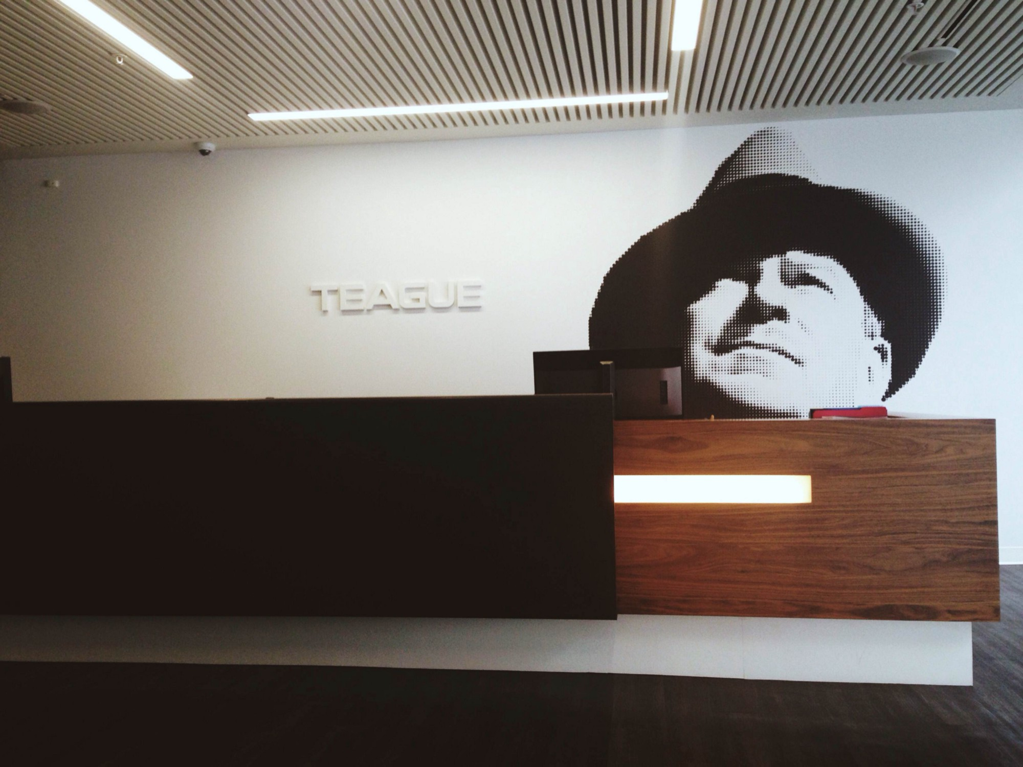 Teague's front desk with the founder himself