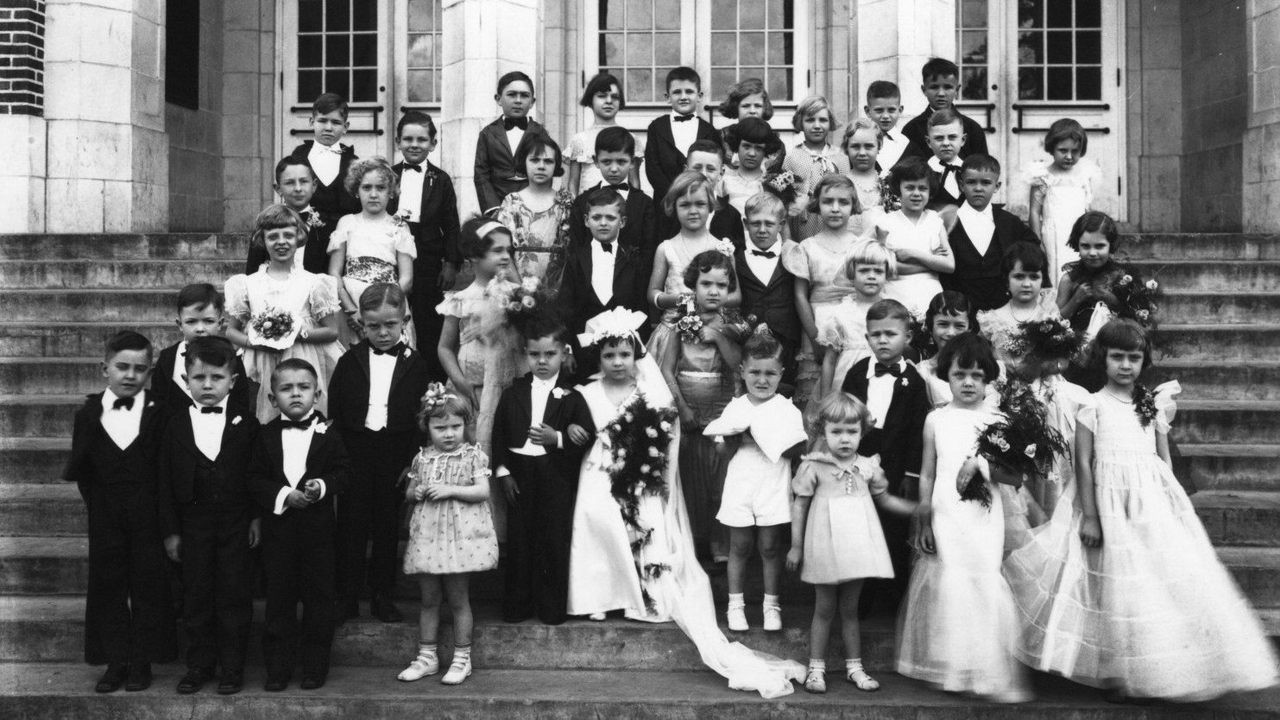 old Black and white photo of a pretend wedding with young children acting as adults