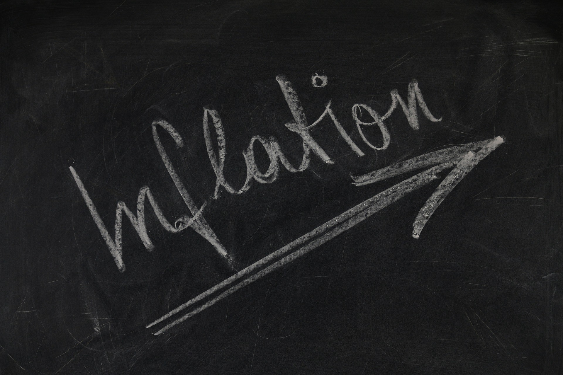 """A chalkboard with the word, """"Inflation""""."""