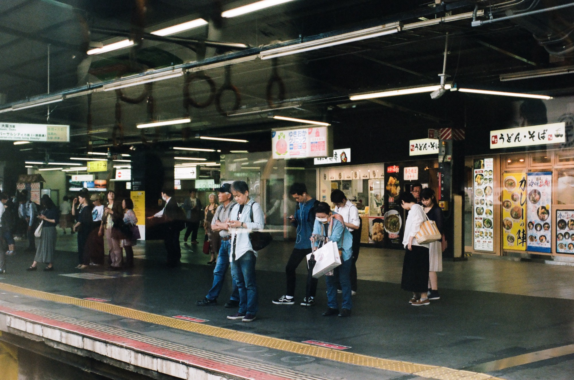 People waiting for the train at the platform in Japan.