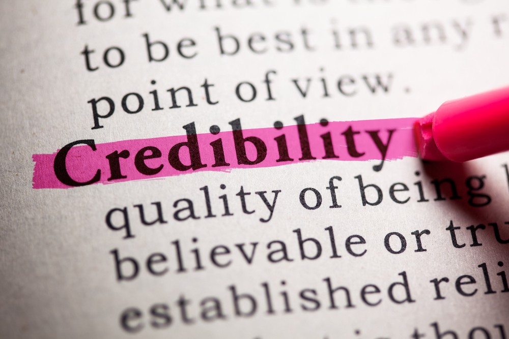 """Image of a dictionary with the term """"Credibility"""" highlighted"""