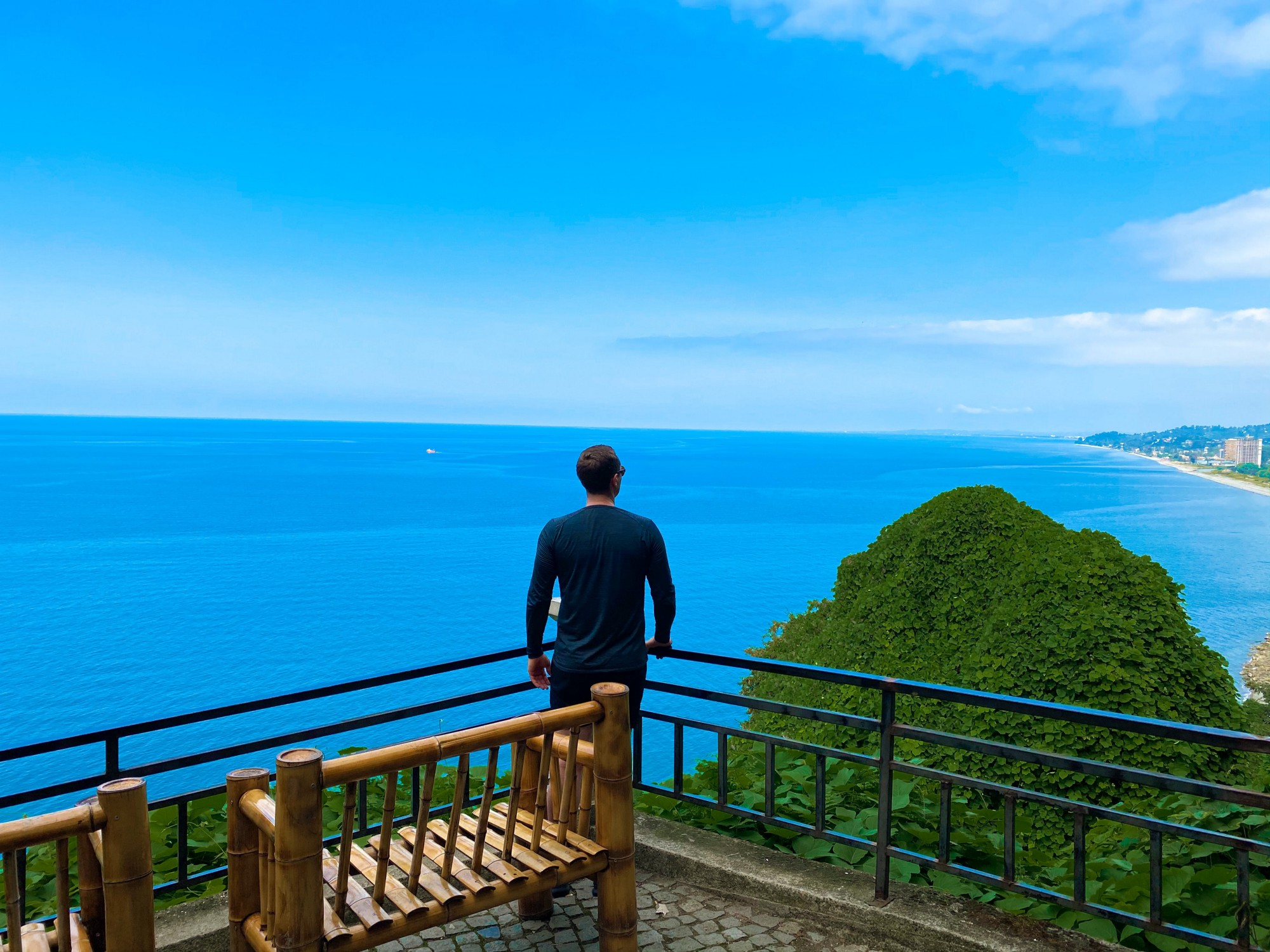 Rules That Will Help You Thrive as a Digital Nomad—man standing on cliff and looking at the sea