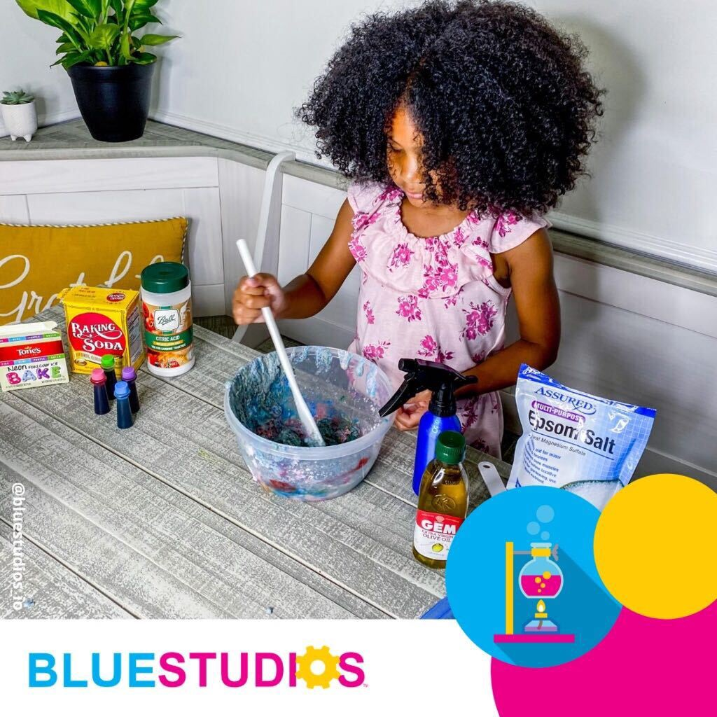 Blue Studios member doing one of our chemistry experiments.