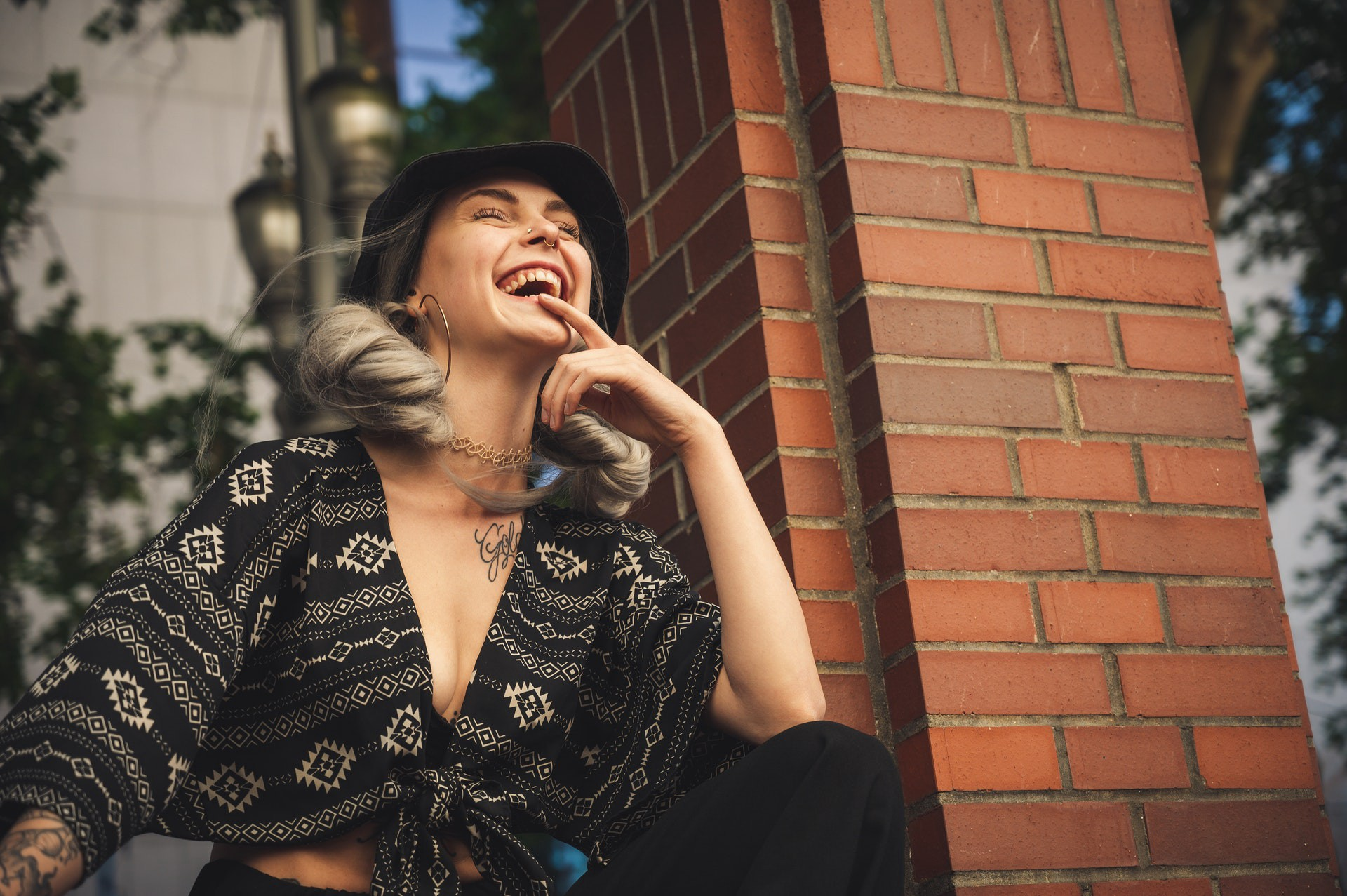 Low angle photo shot of woman smiling wearing crop top