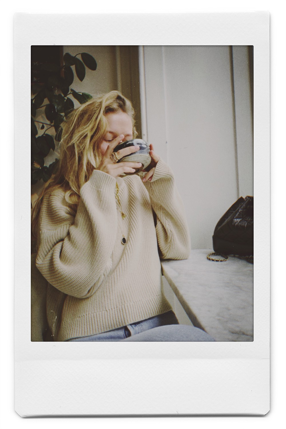 Film camera shot of an instagram model driking coffee