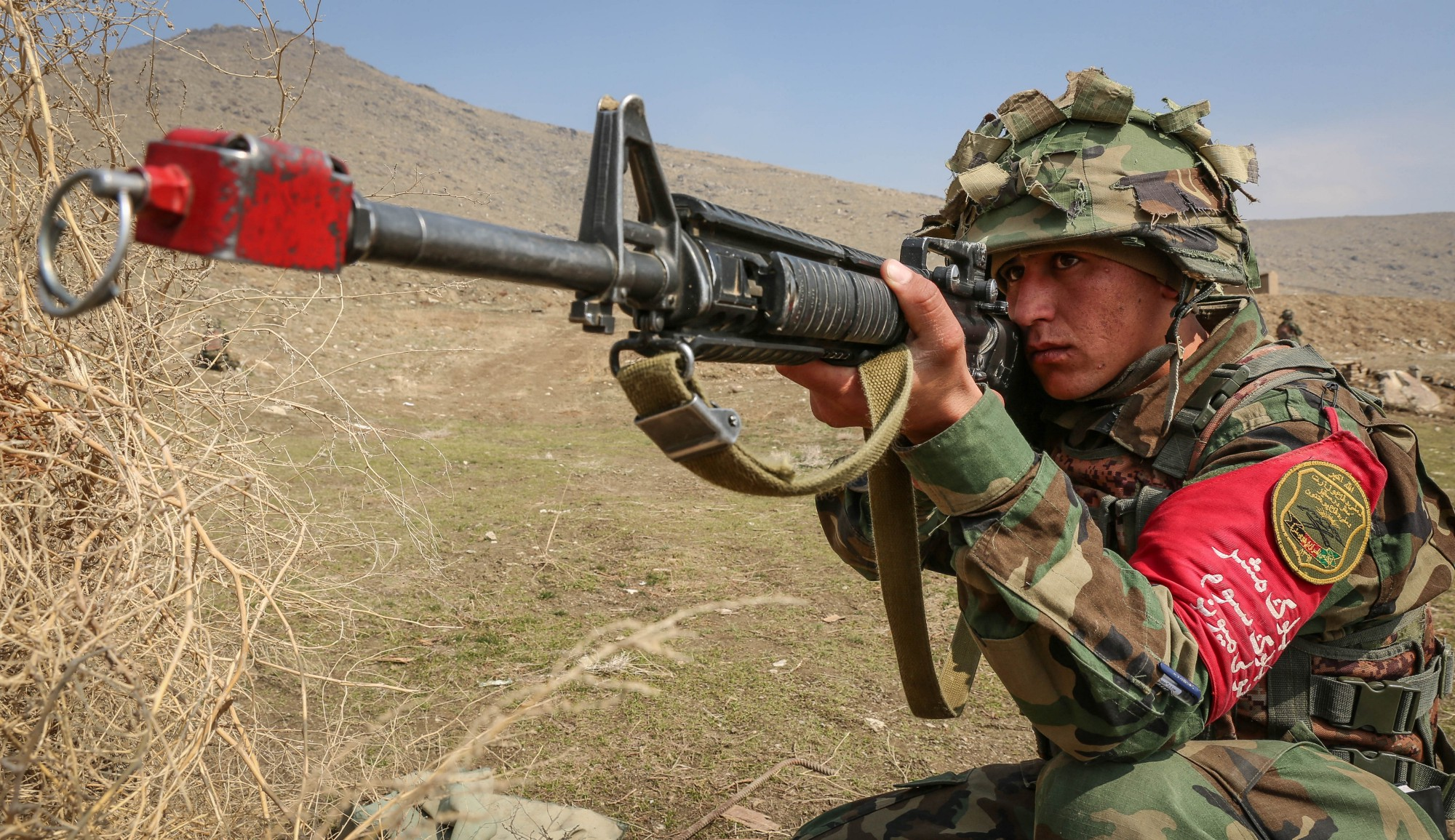 Members of the Afghan National Army take part in an exercise on the ANAOA plains in Kabul.