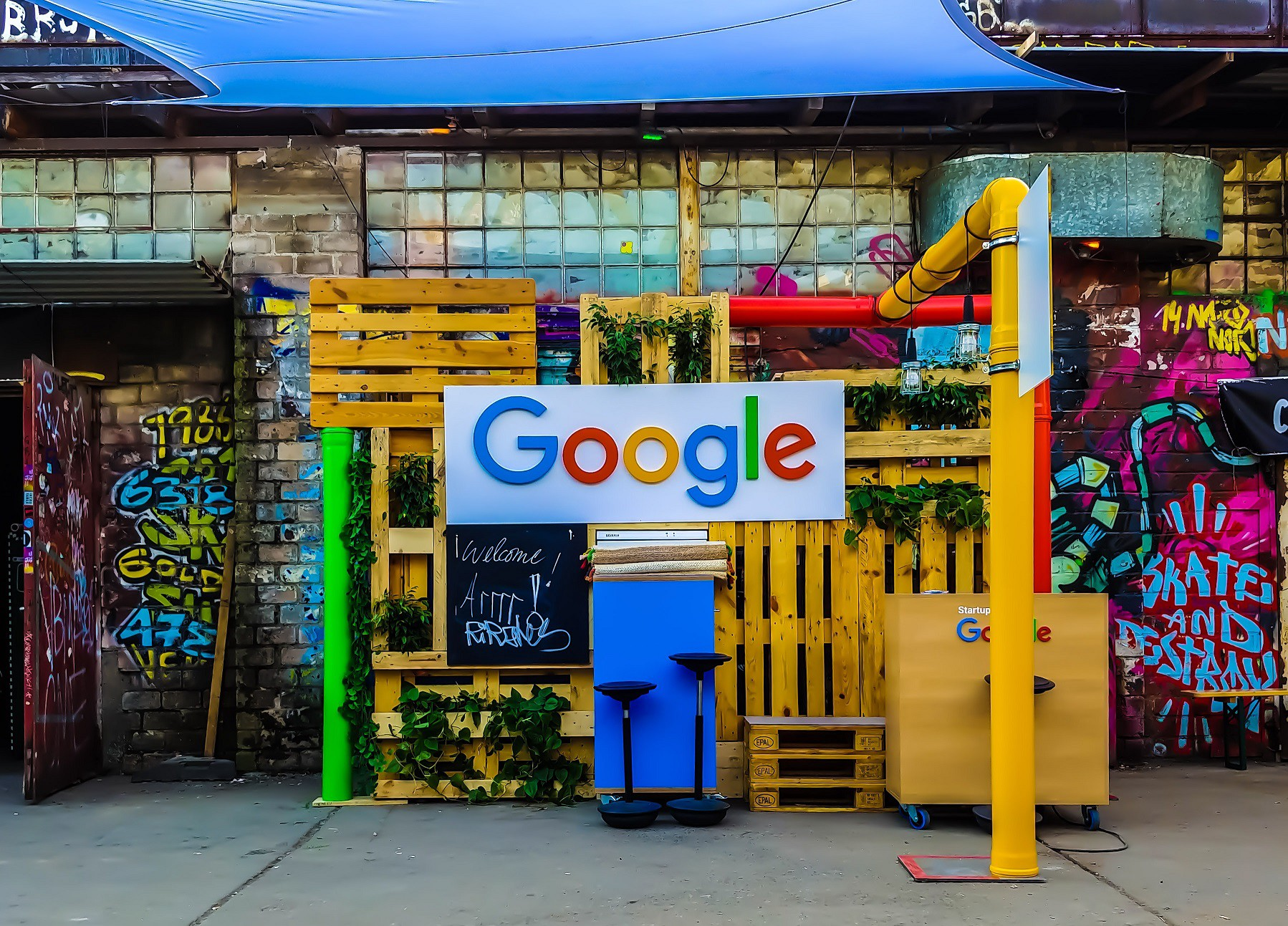 A Google sign at a stand outdoors in a backyard type setting