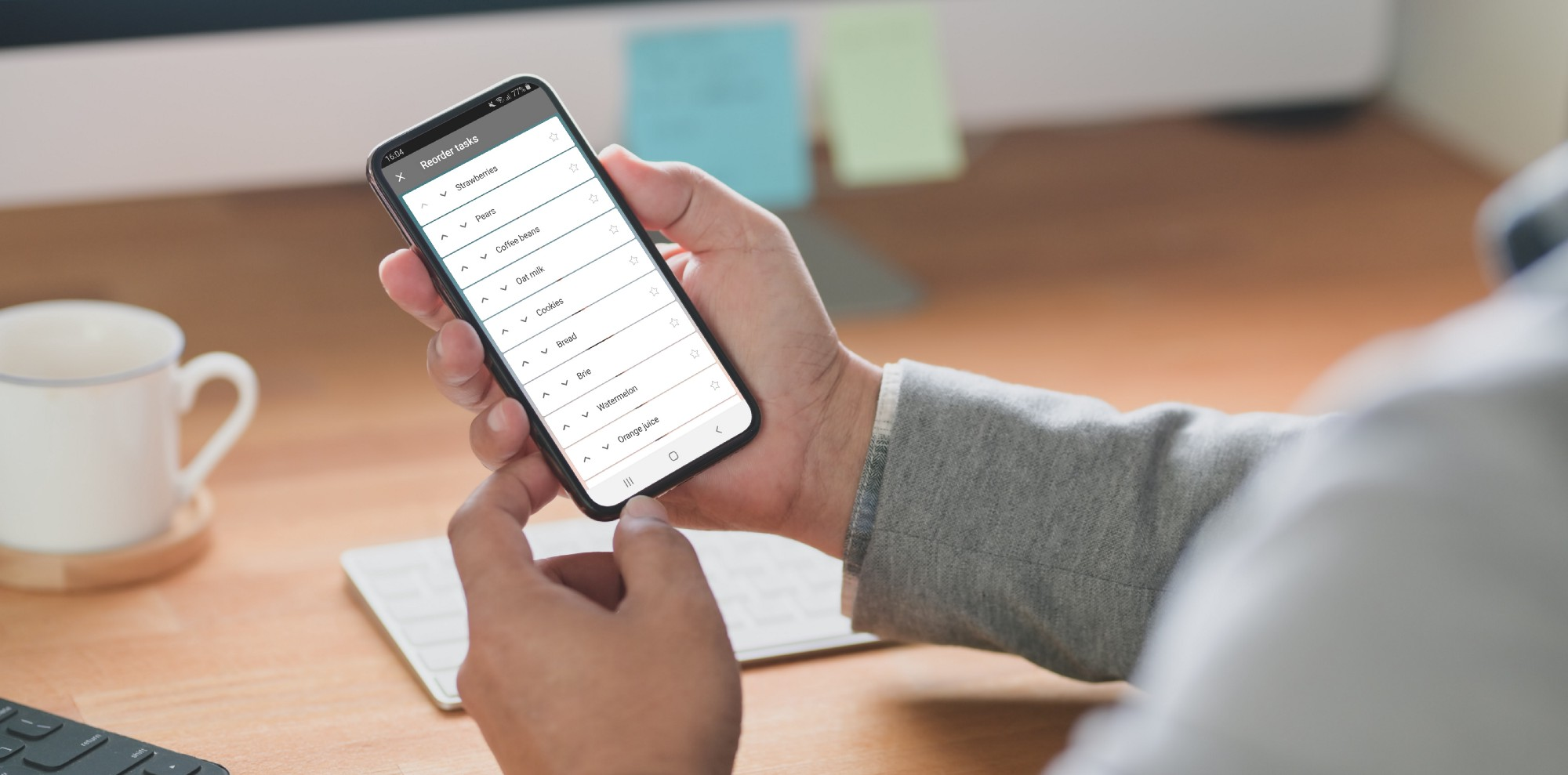 Person using Microsoft To Do app with list open in reorder mode