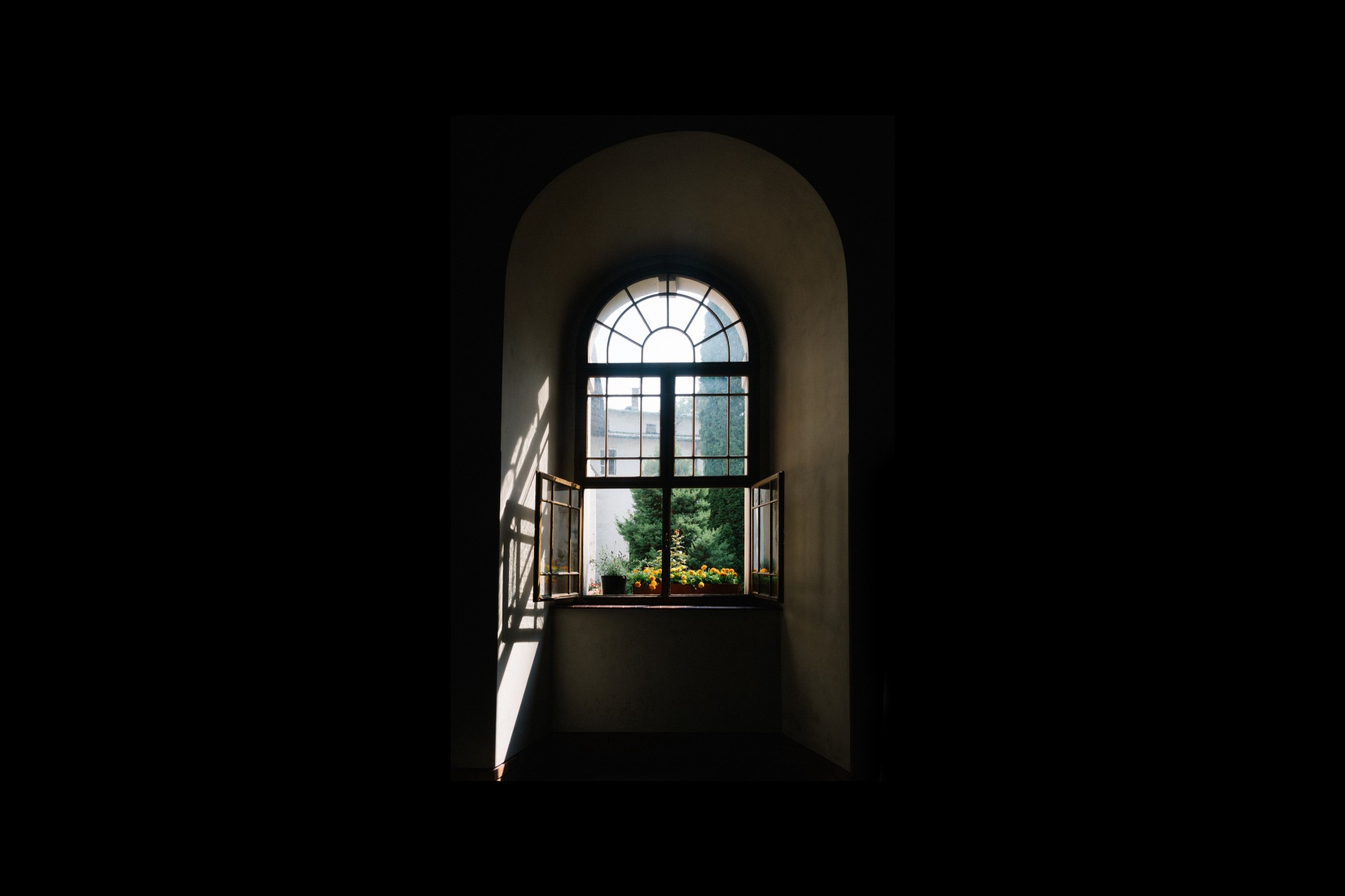 View of a window from inside a house, with the Sun beaming in.