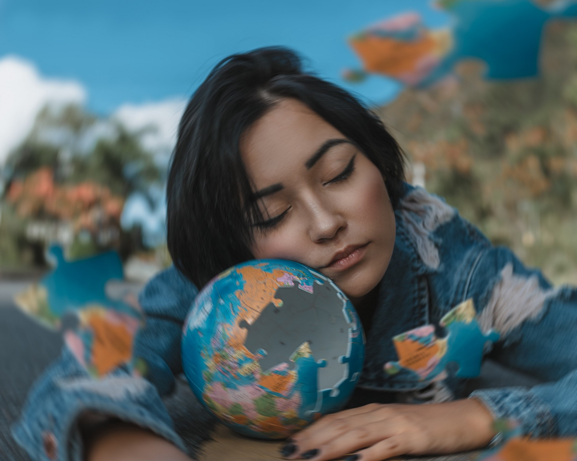 Woman in Blue and White Floral Long Sleeve Shirt Holding A Round Shaped Puzzle and sleeping.
