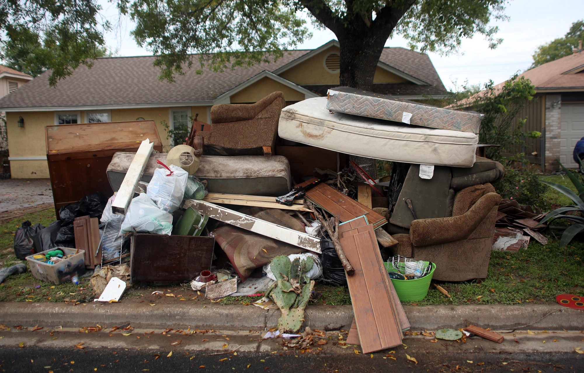 Personal home belongings, destroyed by flood waters, line residential streets during clean up.
