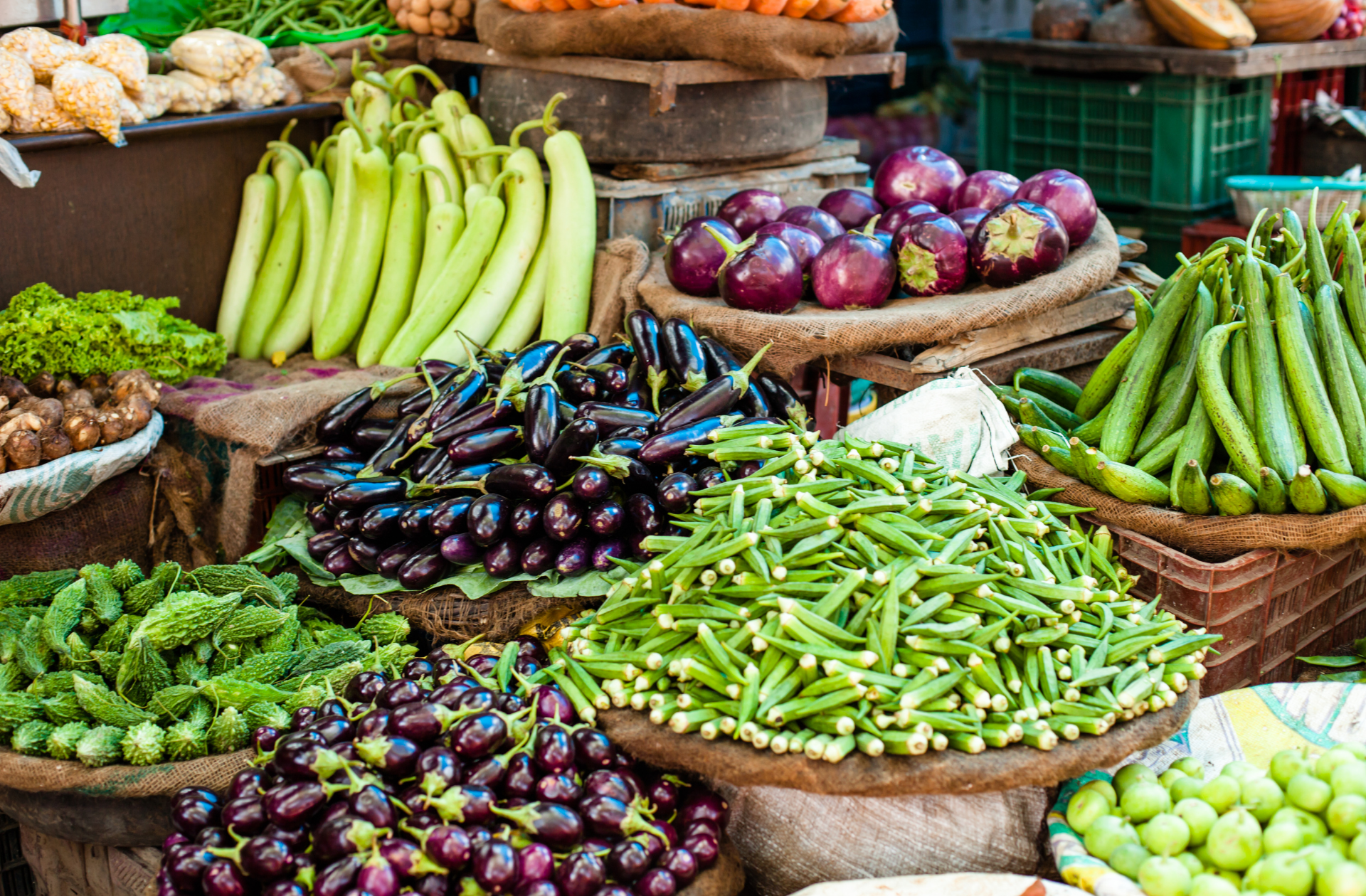 Photo of a vegetable shop in India selling Okra, Egg Plants etc.