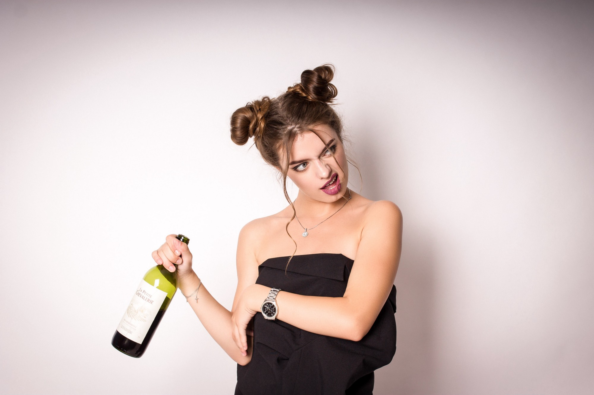 Female with a bottle of wine