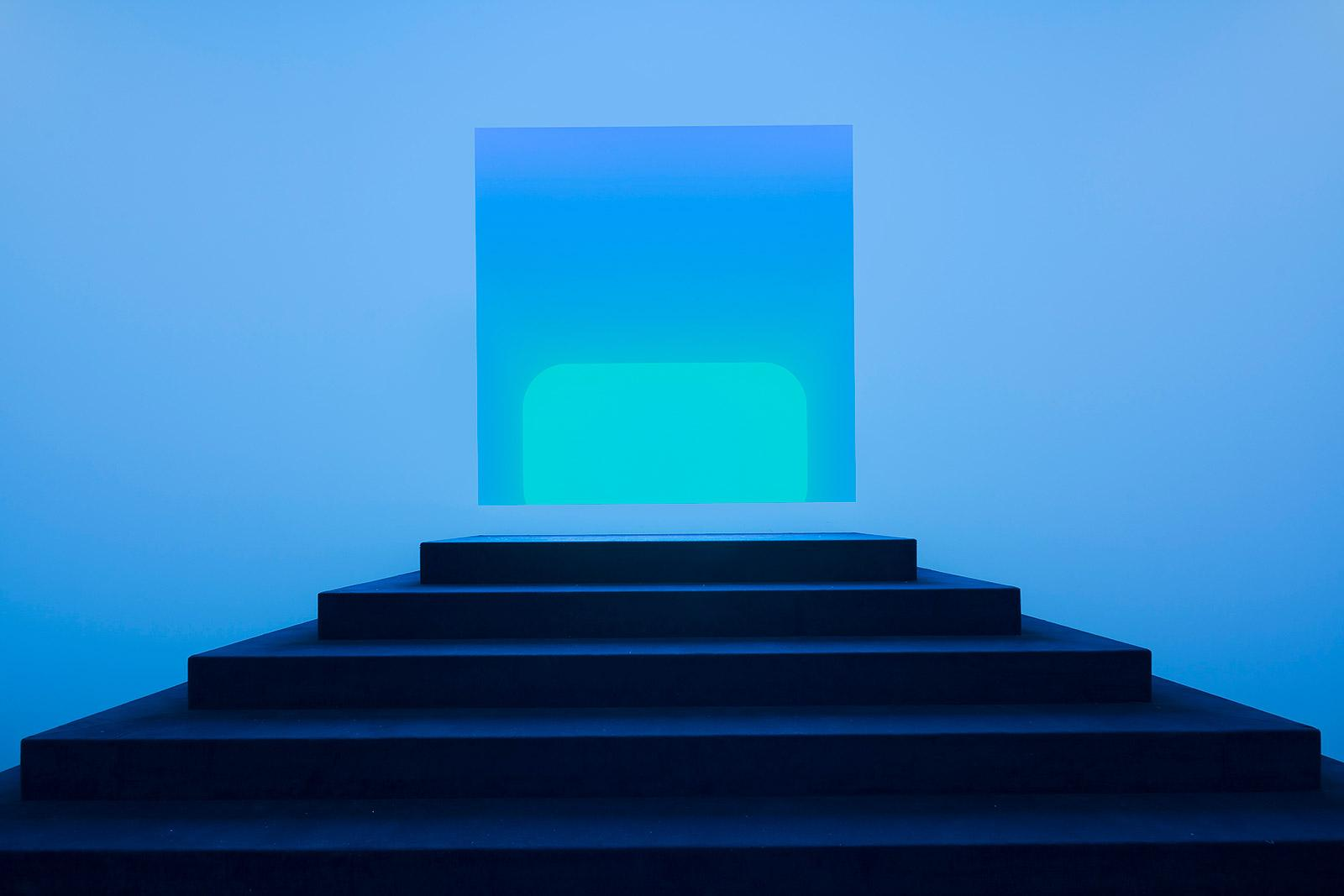 Staircase illuminated by a glowing blue light