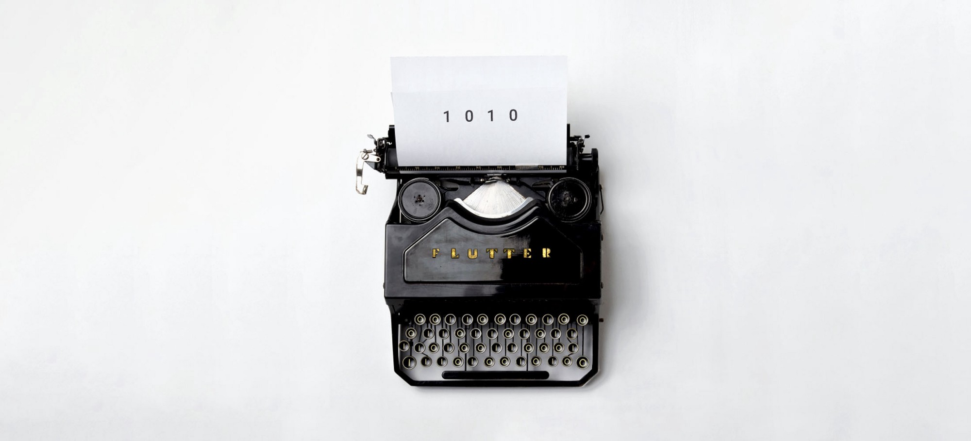 Flutter typewriter with 1010 typed on a white paper