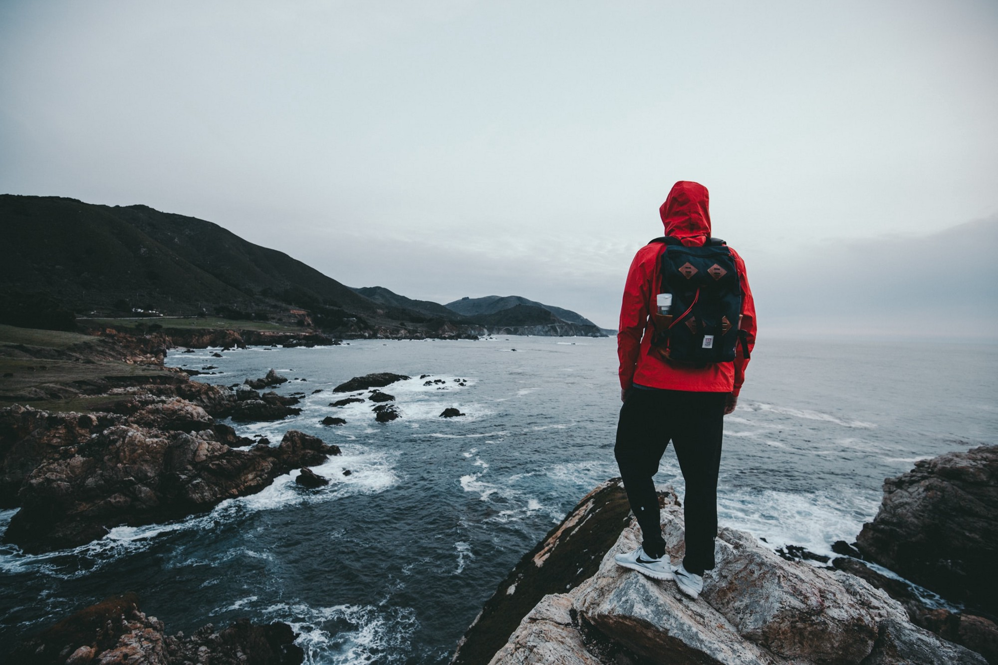 7 Powerful Life Lessons From Living Out of 2 Backpacks For Years — man with red jacket standing on lake
