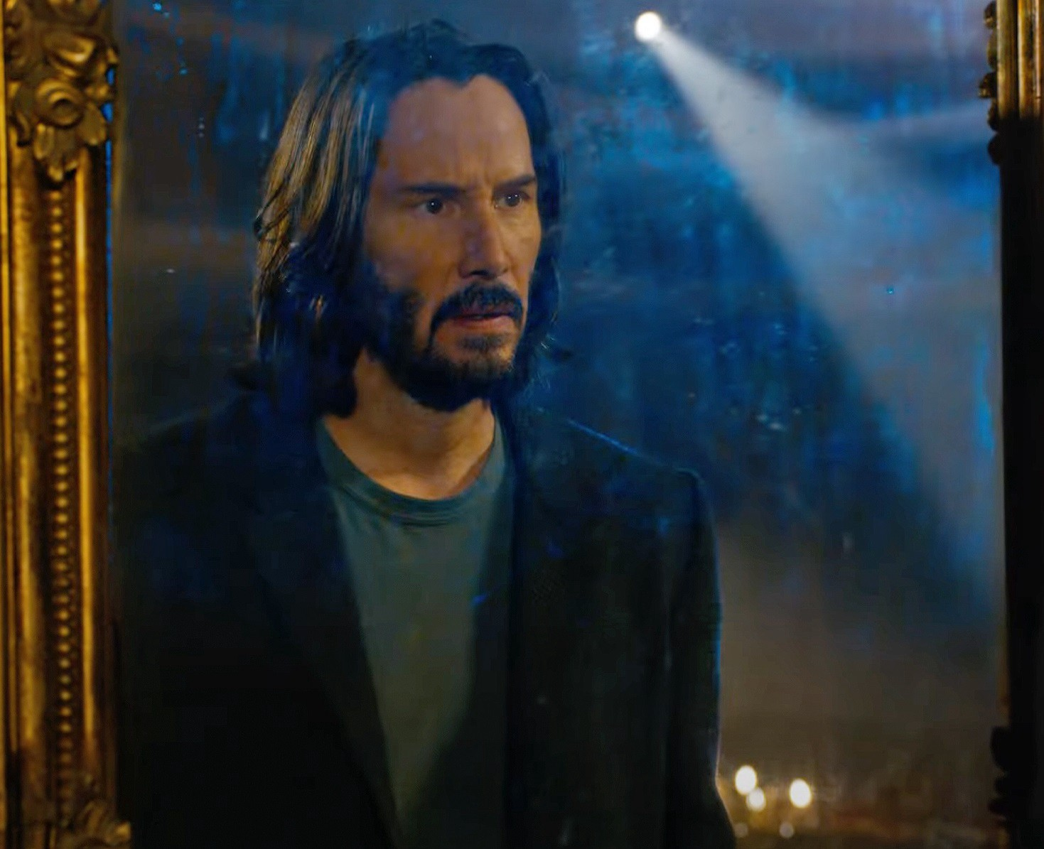Keanu Reeves in the mirror in 'The Matrix Resurrections.'