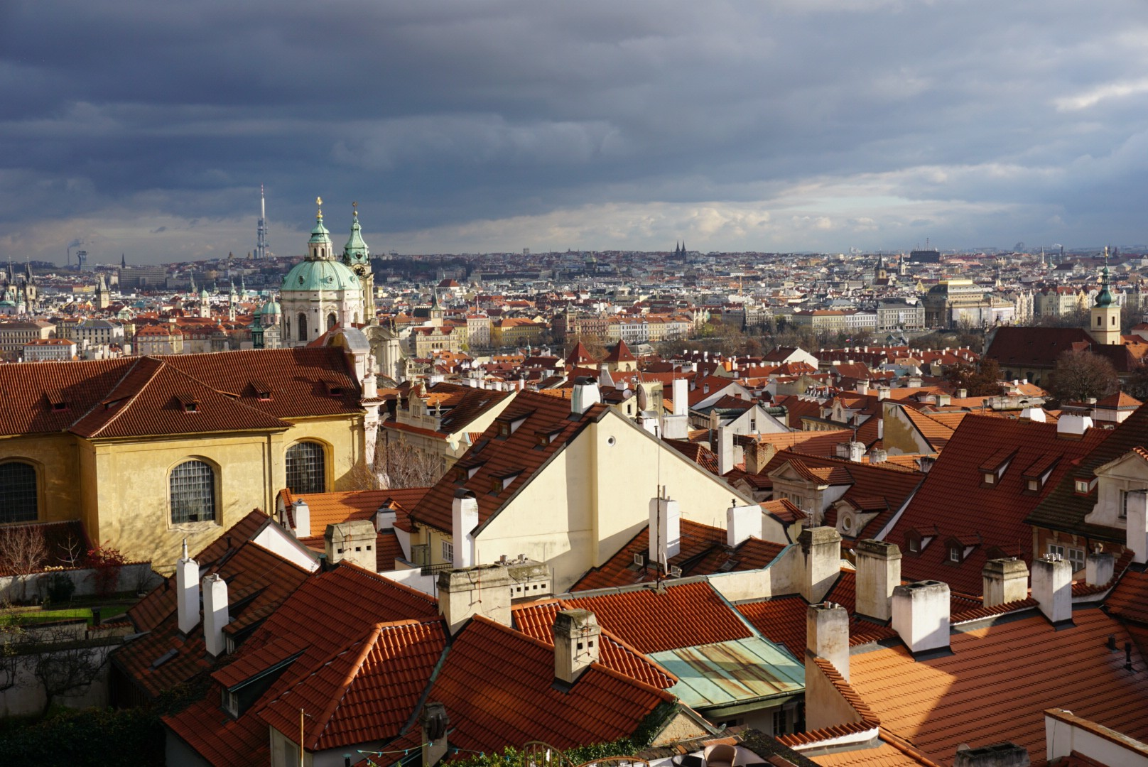 Beautiful skyline of Prague filled with red tiled roofs.