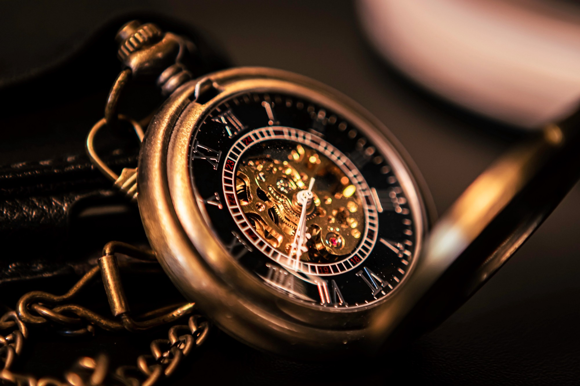 close up of gold pocket watch