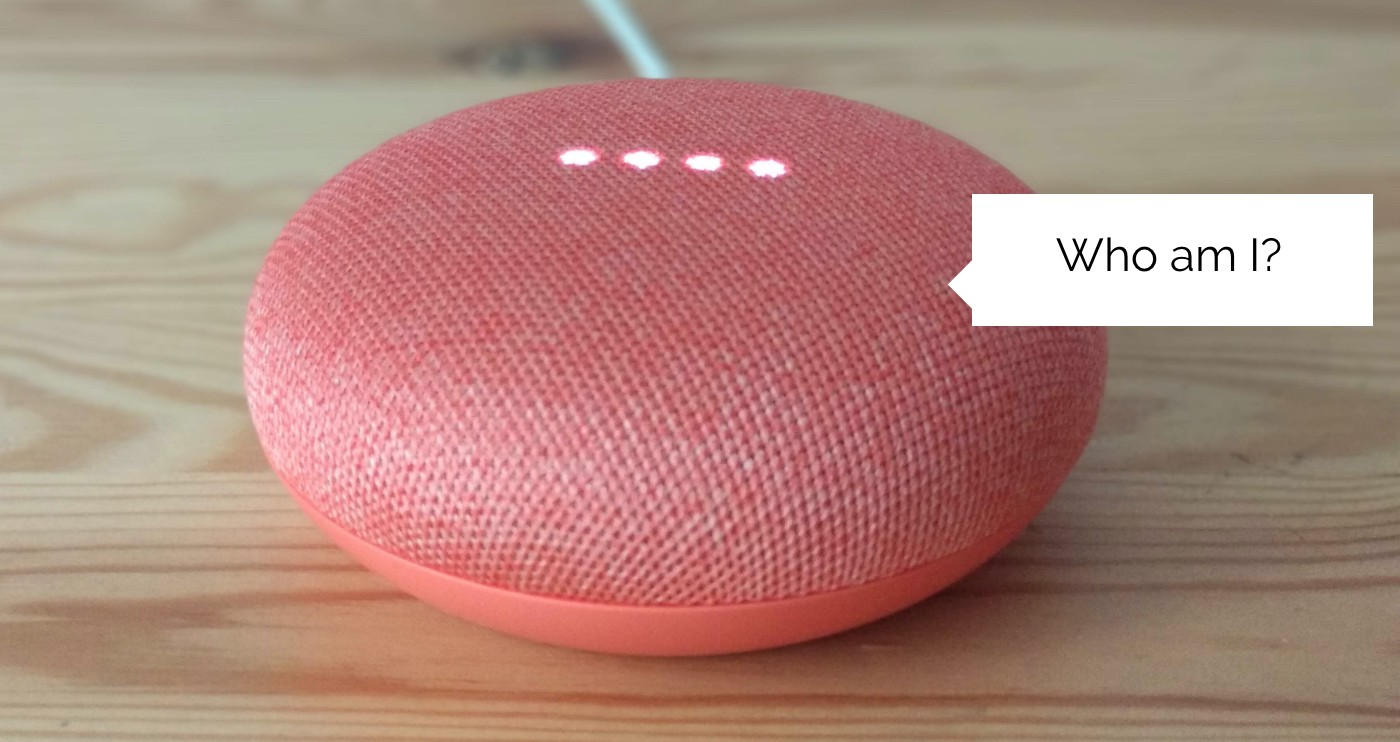"Pink Google Home Mini with a speech bubble saying ""Who am I?"""
