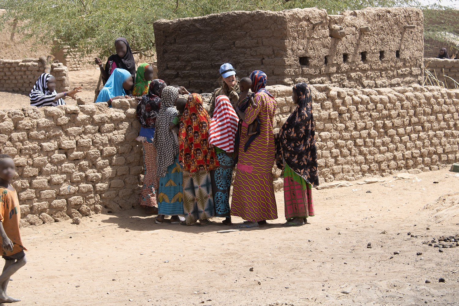 A British peacekeeper talk with locals while out on patrol in Mali.